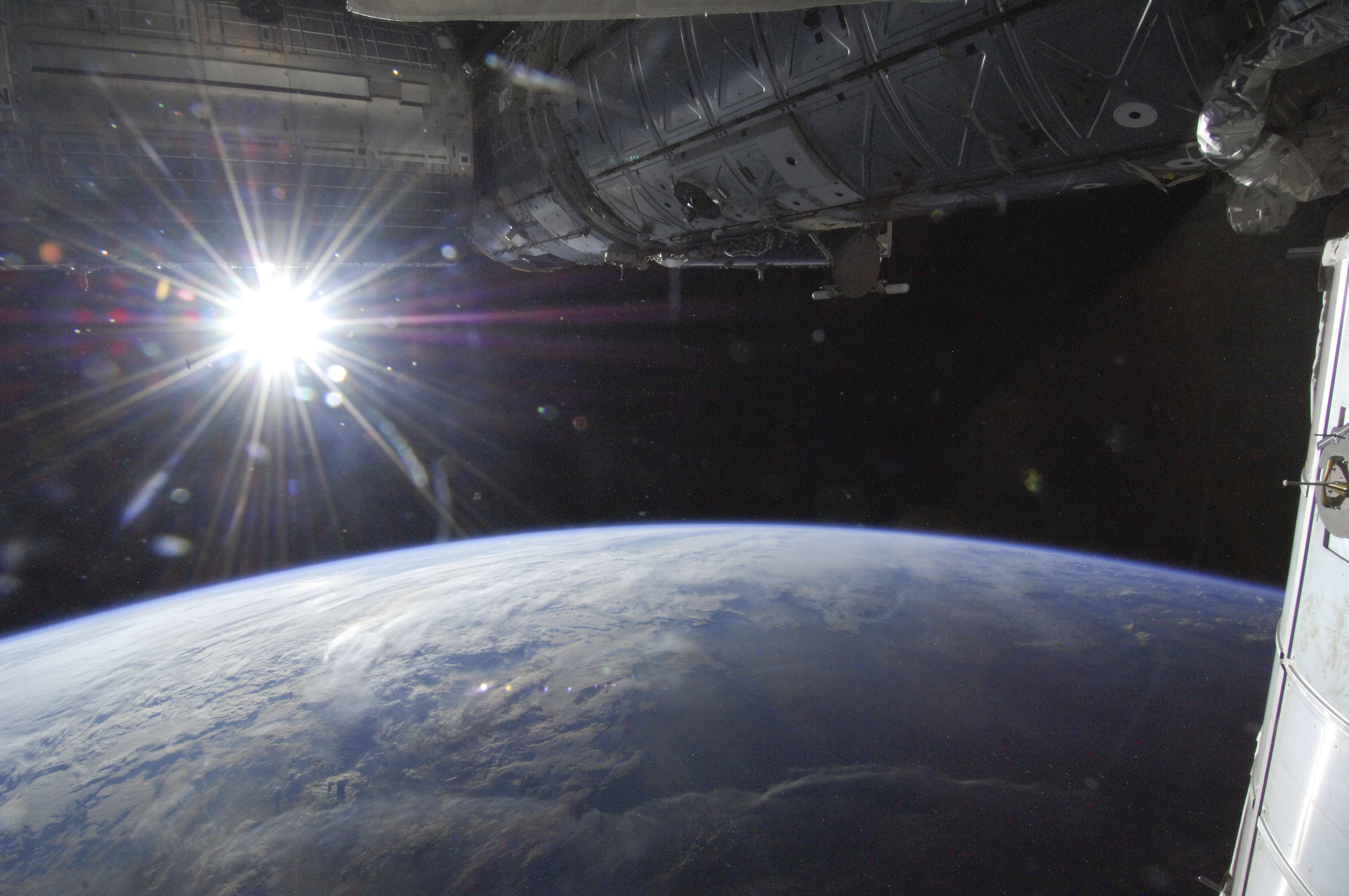 The sun is captured over Earth's horizon by one of the Expedition 36 crew members aboard the International Space Station, as the orbital outpost was above a point in southwestern Minnesota in this May 21, 2013 NASA. REUTERS/NASA/Handout