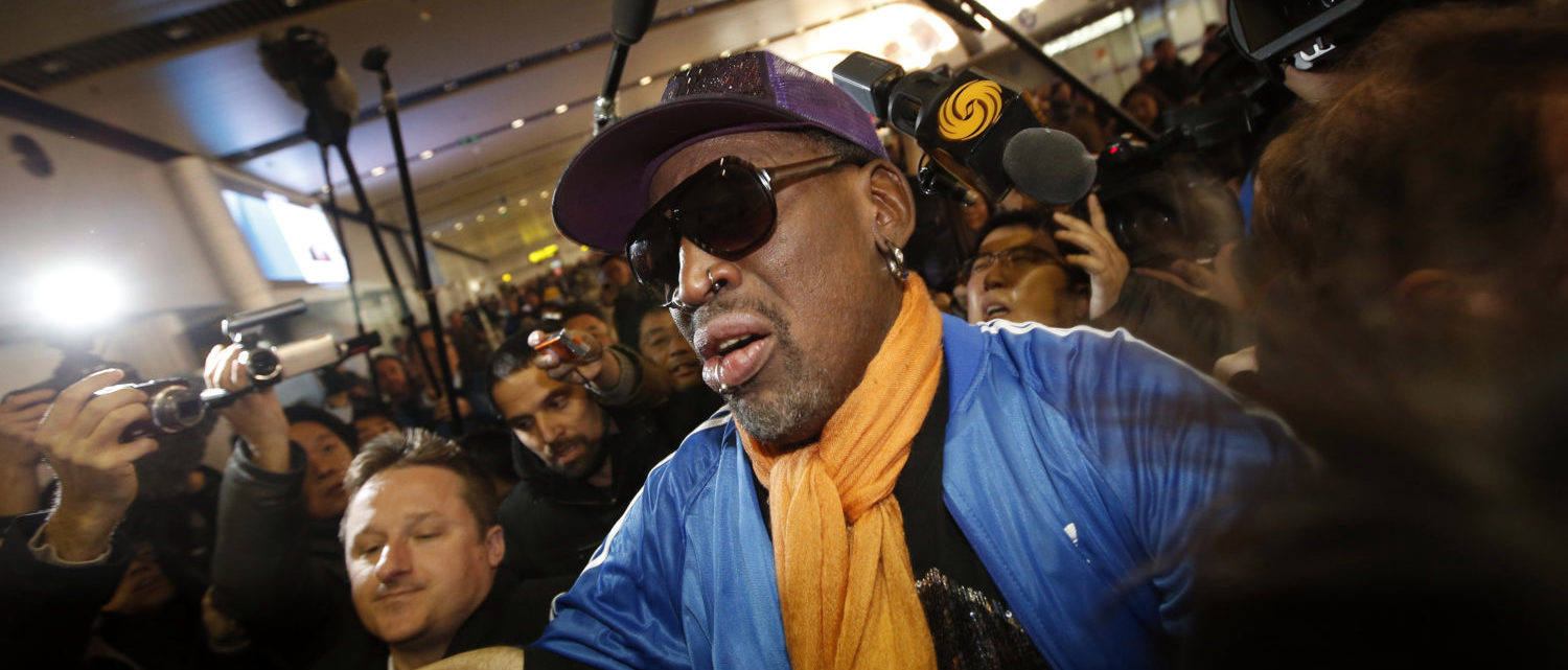 Retired U.S. basketball star Dennis Rodman is surrounded by journalists upon his arrival from North Korea's Pyongyang at Beijing Capital International Airport January 13, 2014.