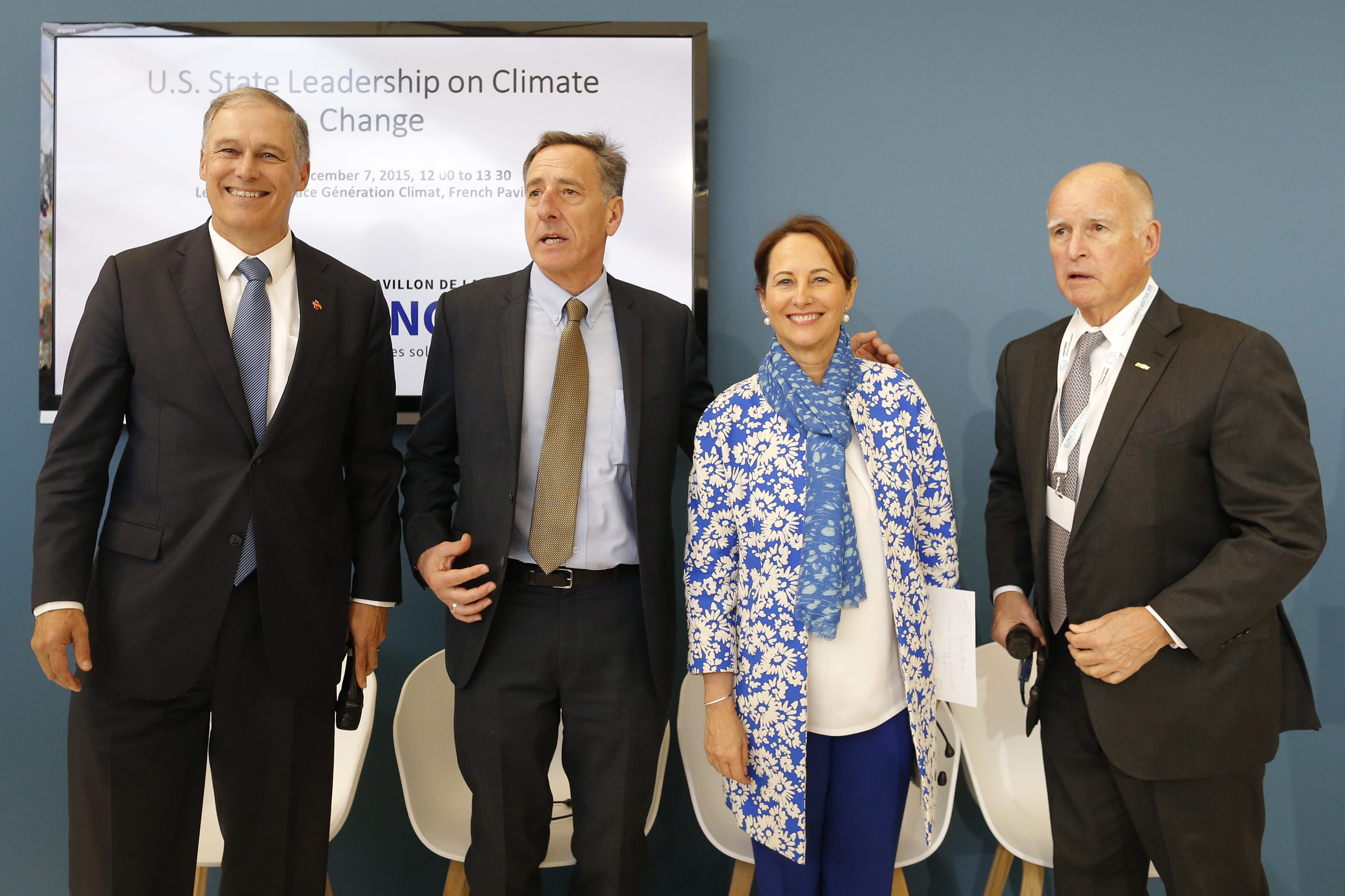 Washington Governor Inslee, Vermont Governor Shumlin, French Ecology Minister Royal, and California Governor Brown pose before a meeting during the World Climate Change Conference 2015 at Le Bourget