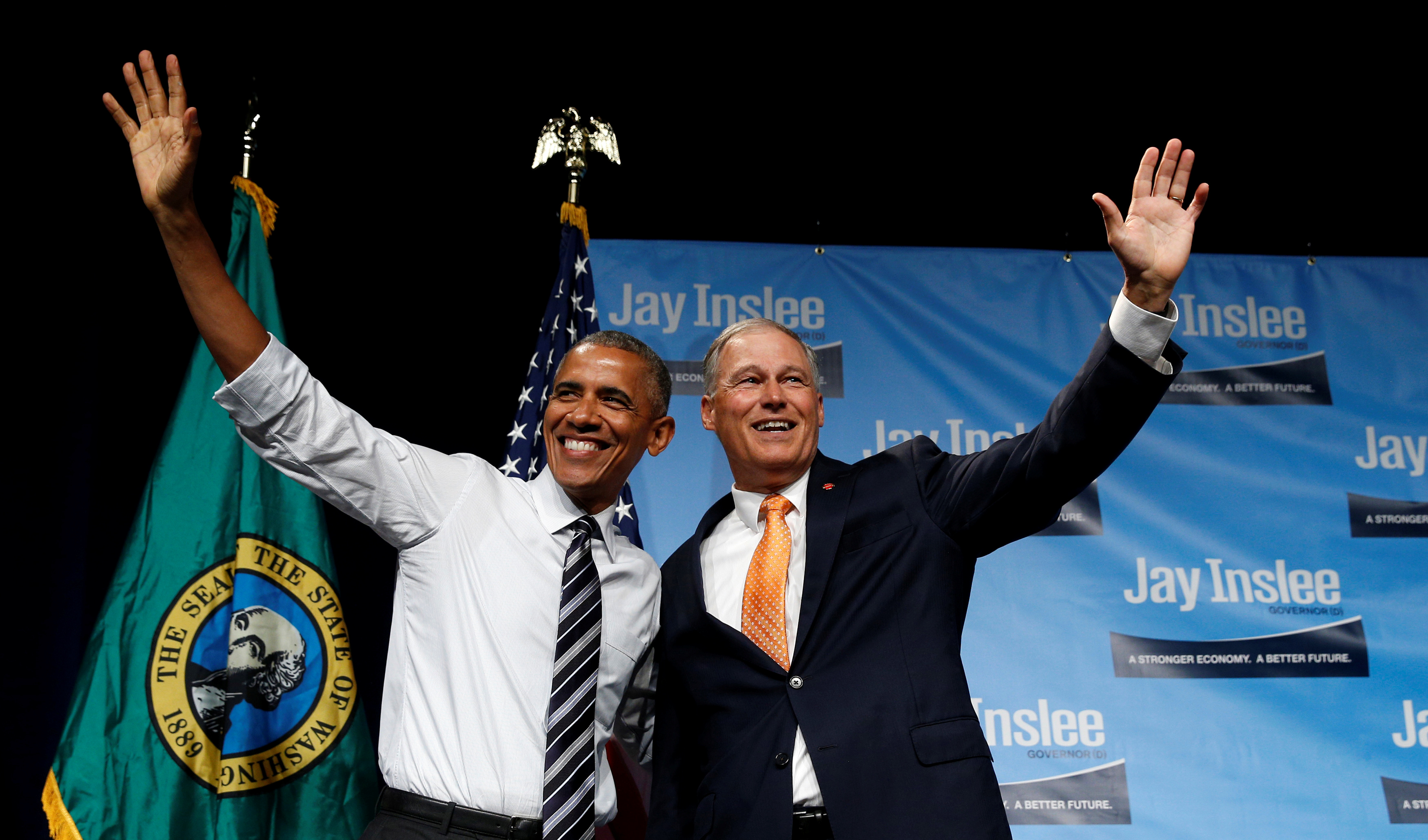 U.S. President Barack Obama waves as he arrives to speak at a fundraiser for Washington Governor Jay Inslee in Seattle