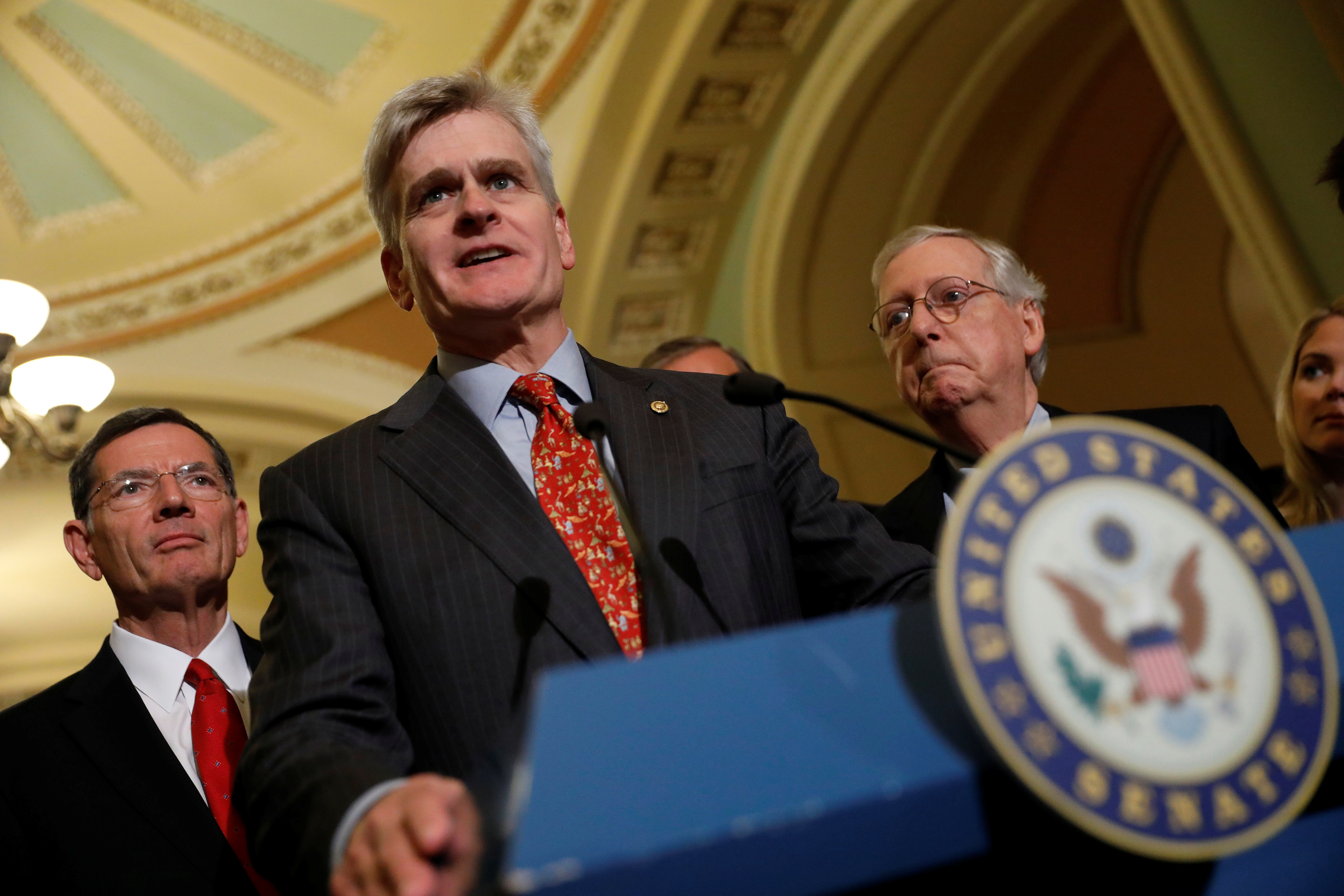 Sen. Cassidy (R-LA), accompanied by Sen. Barrasso (R-WY) and Senate Majority Leader McConnell, speaks with reporters about the Cassidy/Graham healthcare bill following the party luncheons on Capitol Hill in Washington