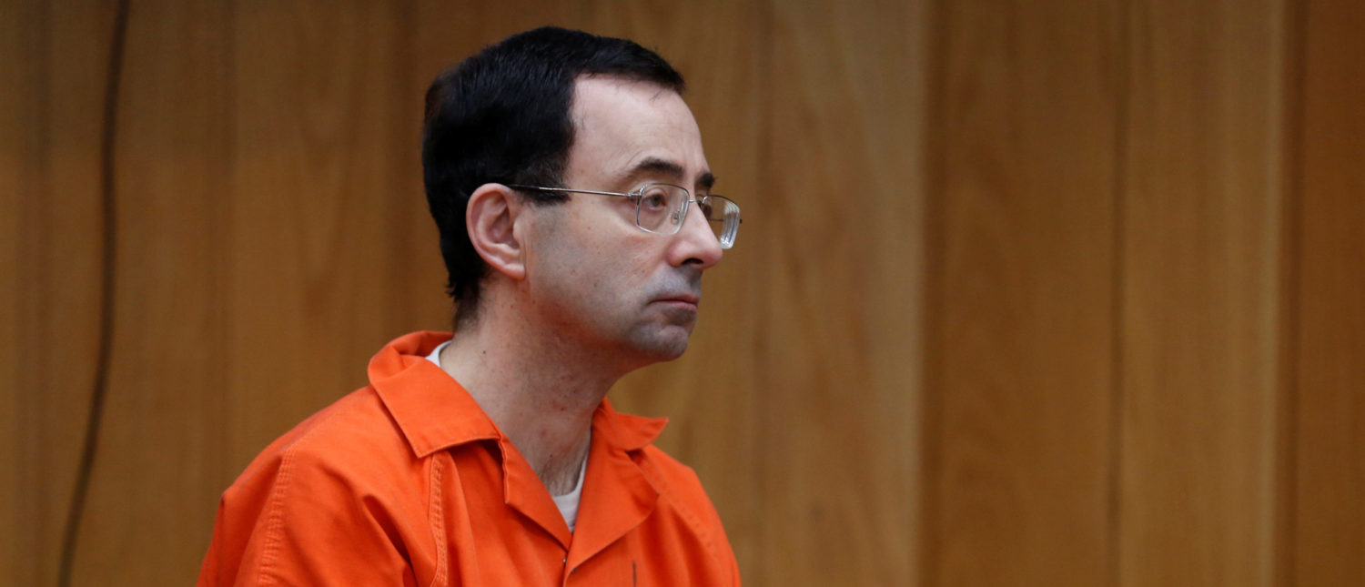 Larry Nassar, a former team USA Gymnastics doctor who pleaded guilty in November 2017 to sexual assault charges, listens to Judge Janice Cunningham during his sentencing hearing in the Eaton County Court in Charlotte, Michigan, U.S., February 5, 2018. REUTERS/Rebecca Cook