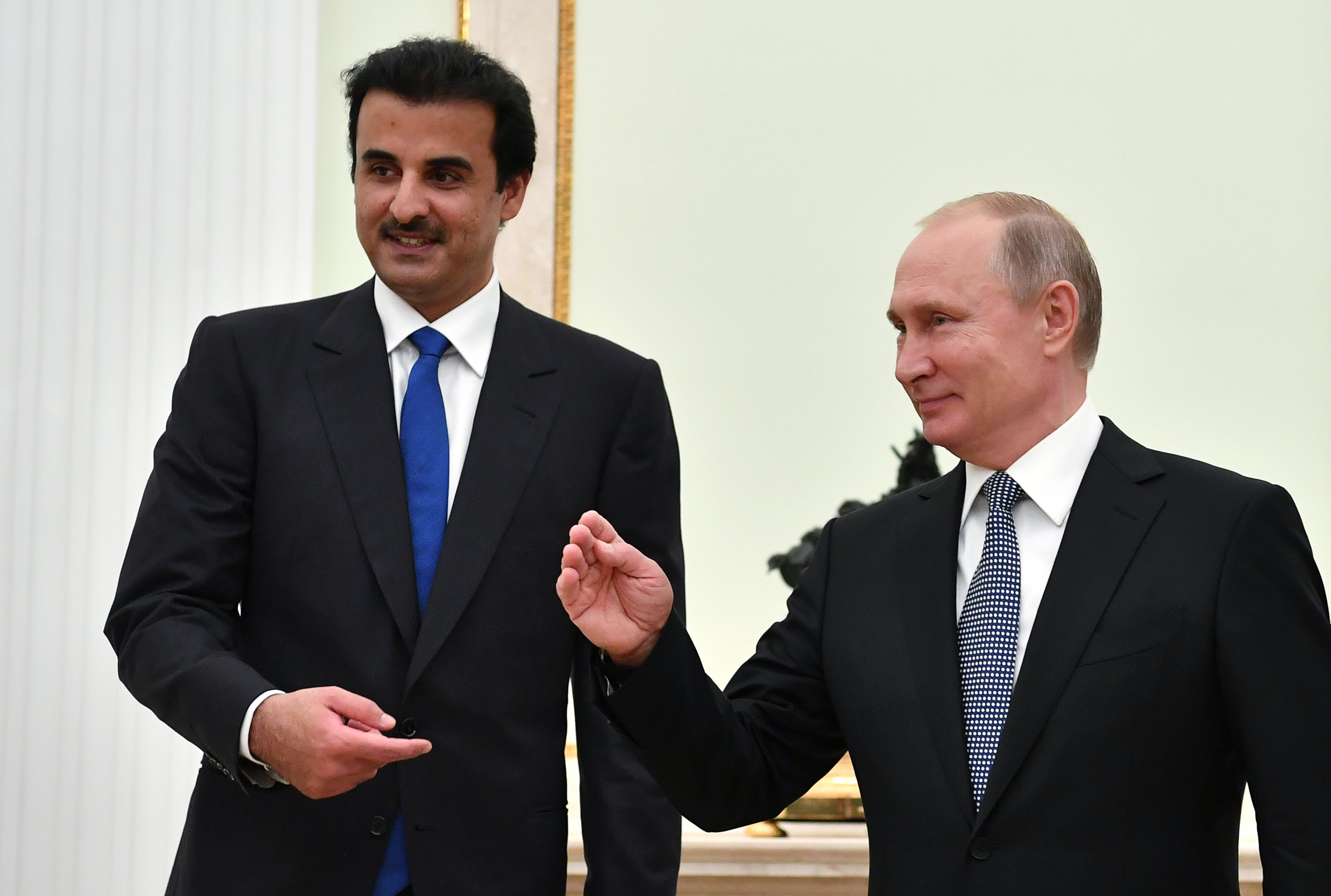 Russian President Vladimir Putin and Qatar Emir Sheikh Tamim bin Hamad al-Thani attend a meeting at the Kremlin in Moscow, Russia July 15, 2018. Yuri Kadobnov/Pool via REUTERS