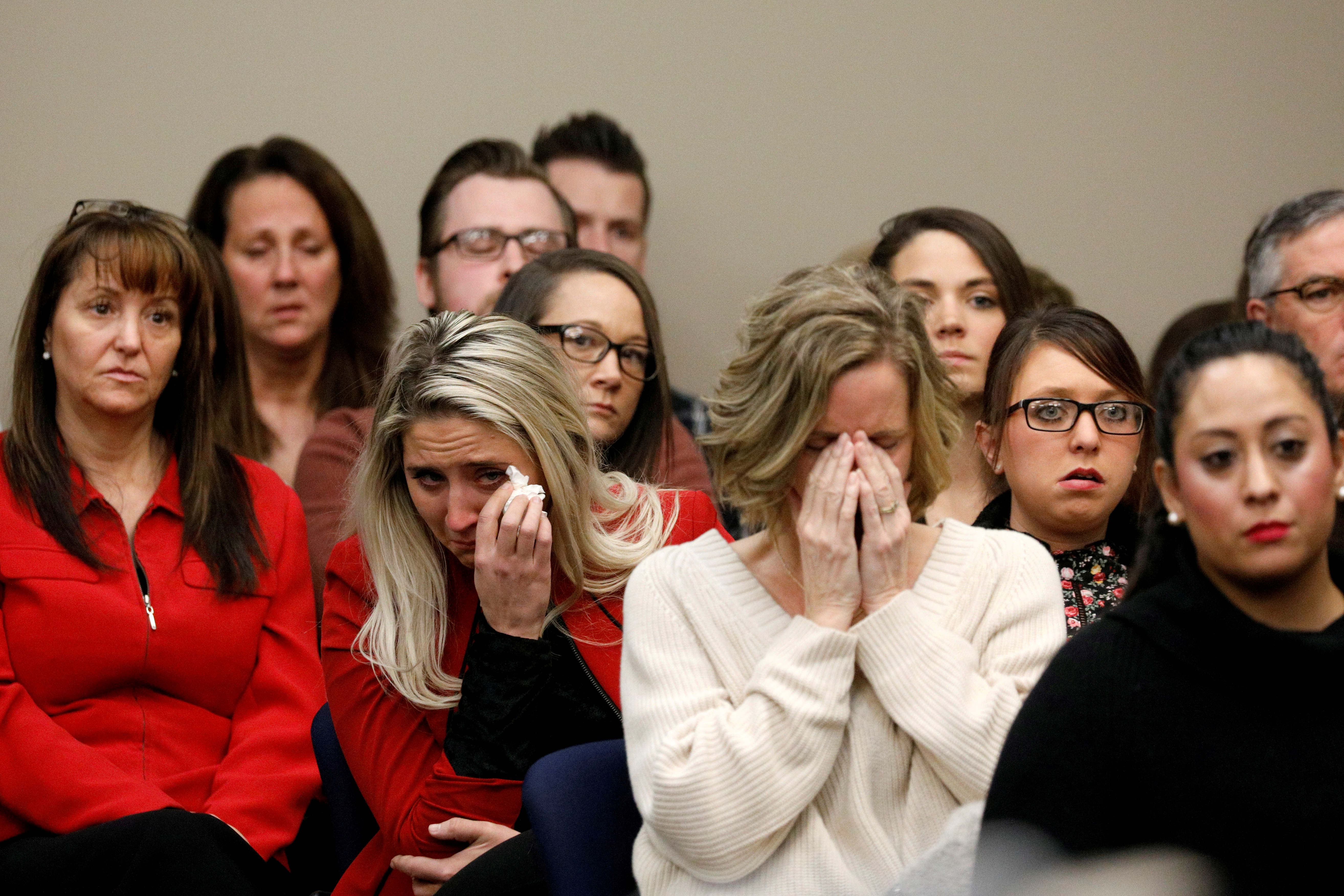 Victims and others look on as Rachael Denhollander speaks at the sentencing hearing for Larry Nassar, a former team USA Gymnastics doctor who pleaded guilty in November 2017 to sexual assault charges, in Lansing, Michigan, U.S., January 24, 2018. REUTERS/Brendan McDermid