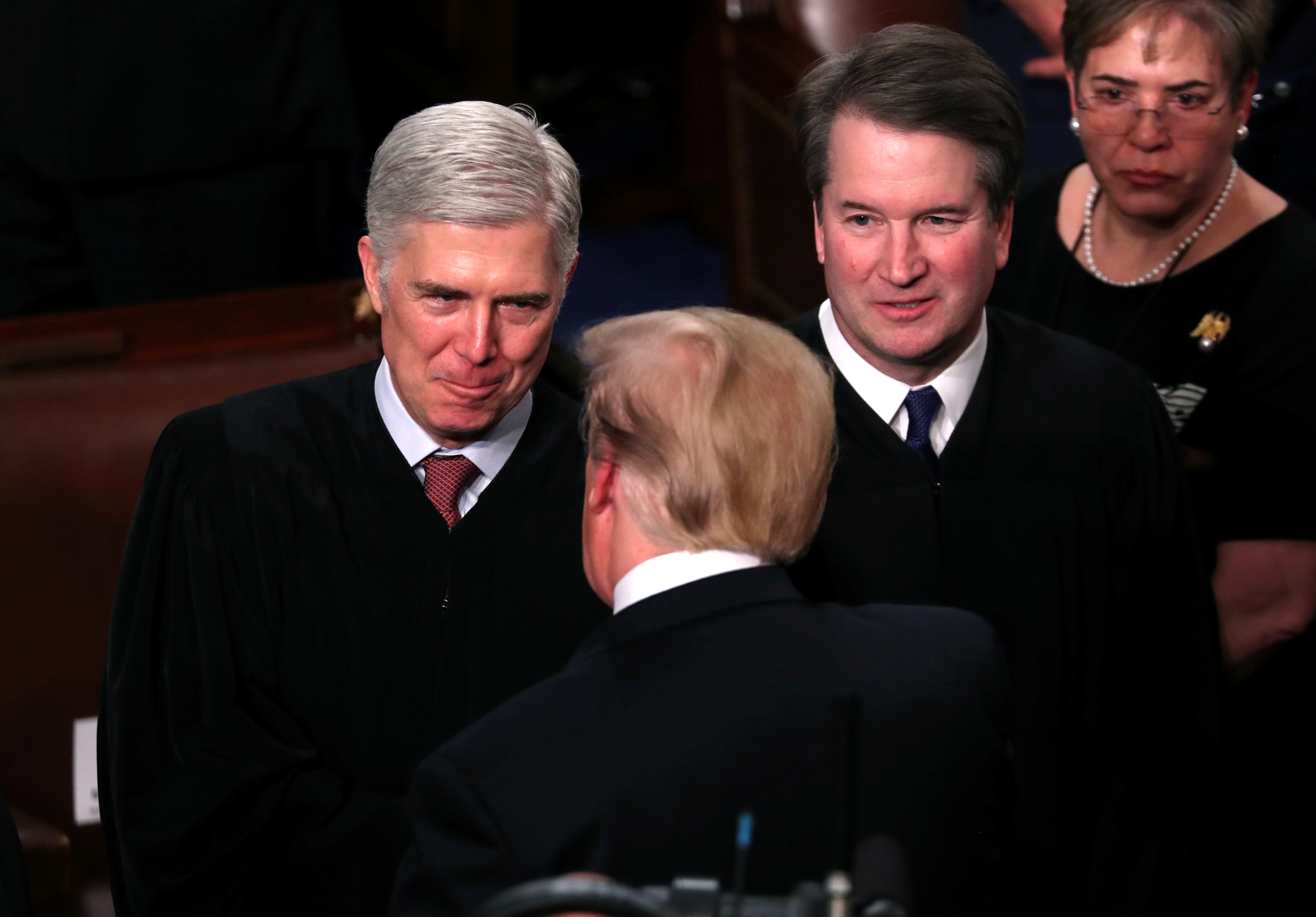 U.S. President Donald Trump greets Supreme Court justices as he arrives to deliver his second State of the Union address to a joint session of the U.S. Congress in Washington