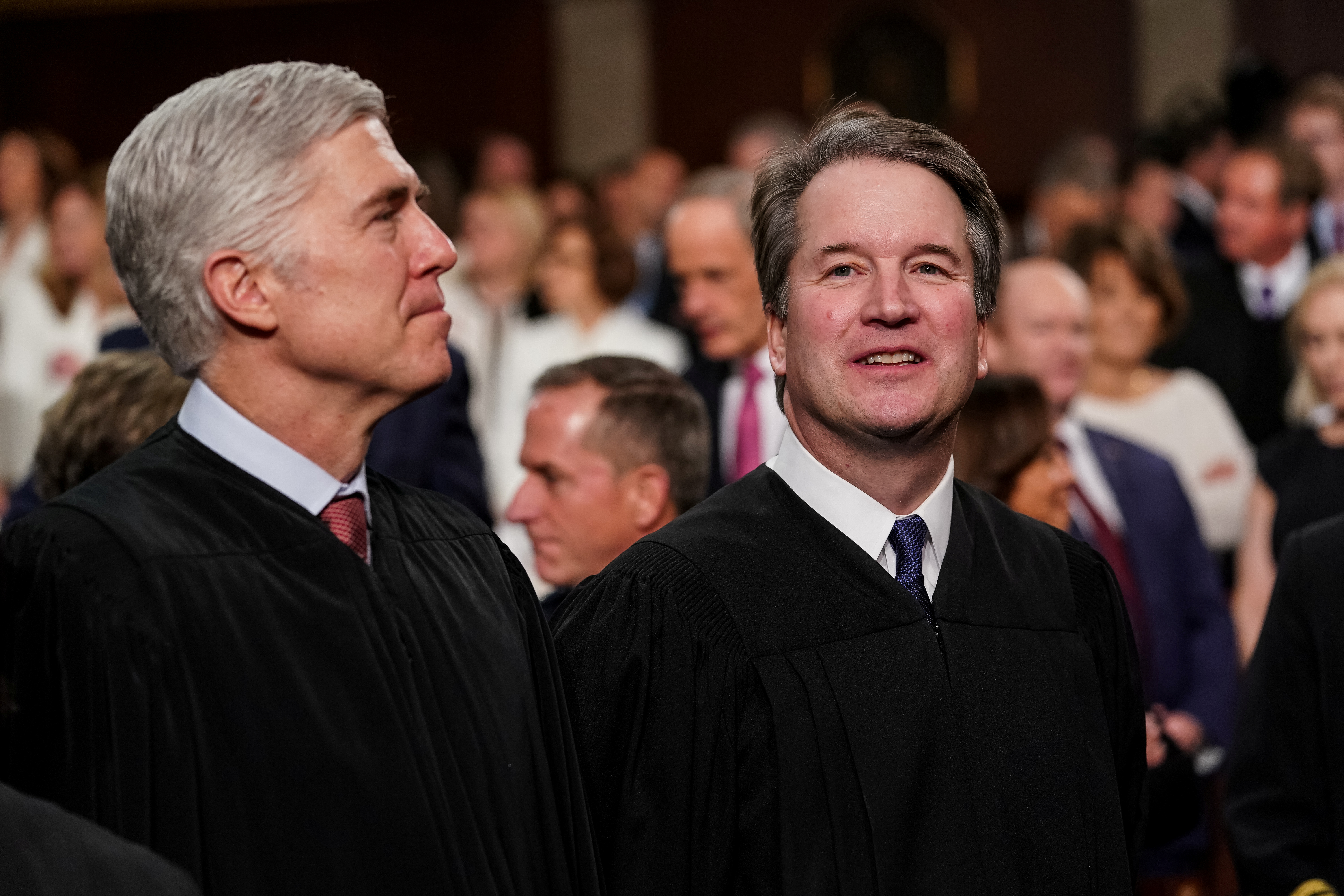 Supreme Court justices Neil Gorsuch, left, and Brett Kavanaugh at the Capitol in Washington