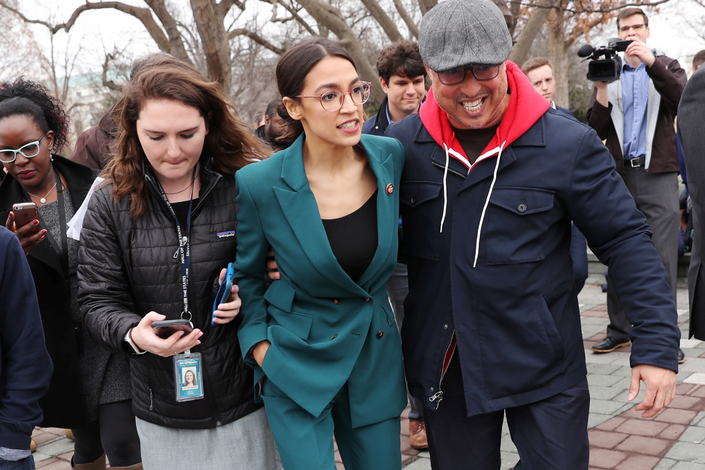 "U.S. Representative Ocasio-Cortez moves through a group of reporters after a news conference for the proposed ""Green New Deal"" at the U.S. Capitol in Washington"