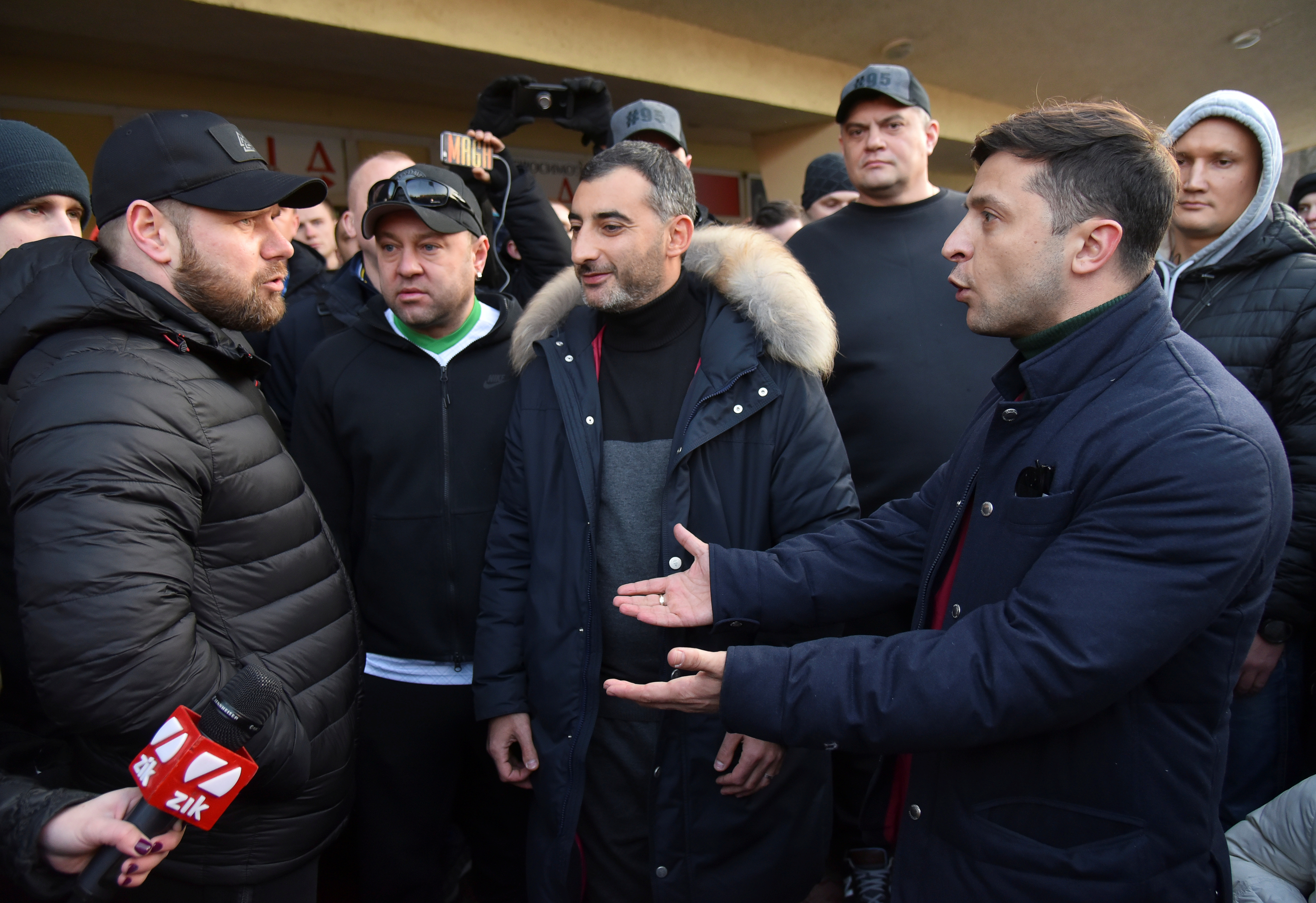 Volodymyr Zelenskiy (R), Ukrainian actor and candidate in the upcoming presidential election, argues with his opponents, who stage a protest prior to Zelenskiy's concert in Lviv, Ukraine February 8, 2019. REUTERS/Mykola Tys