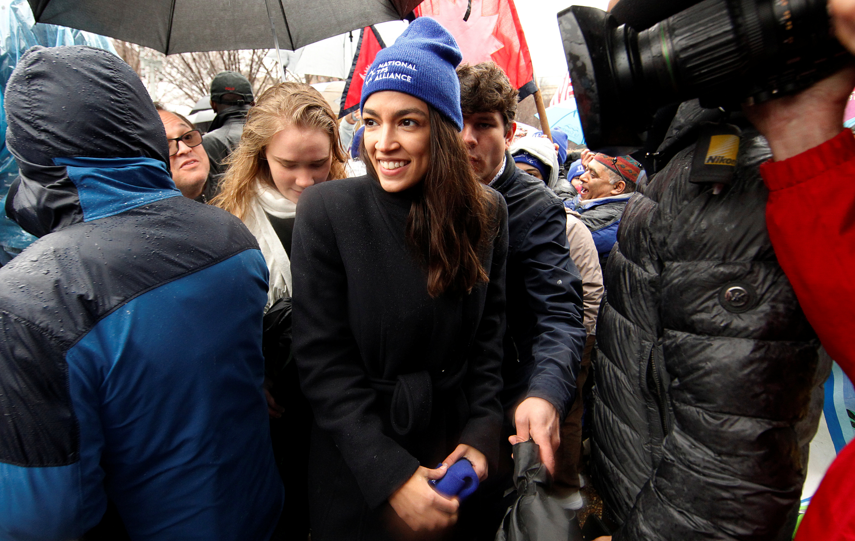 Rep. Alexandria Ocasio-Cortez addresses immigration rights activists during a rally in front of the White House in Washington