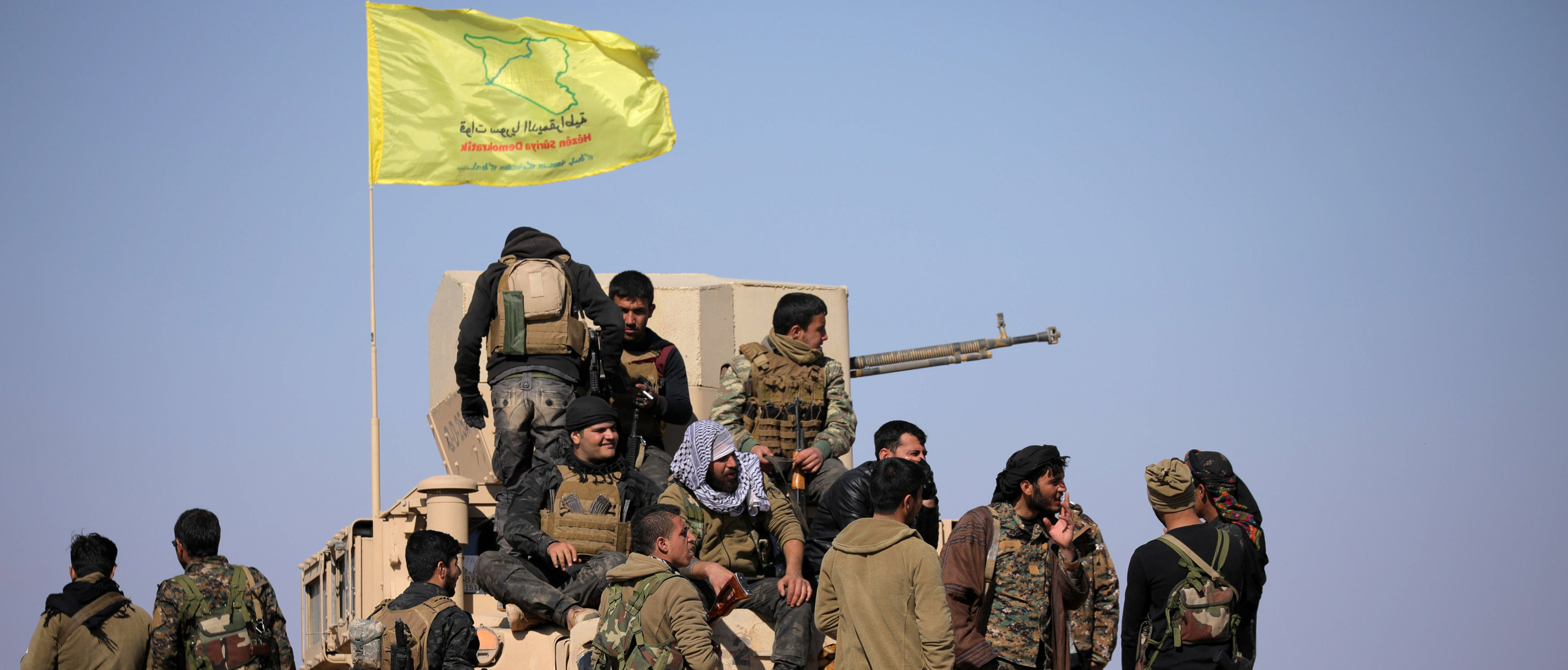 Members of Syrian Democratic Forces (SDF) stand together near Baghouz, Deir Al Zor province, Syria February 12, 2019. Picture taken February 12, 2019. REUTERS/ Rodi Said - RC1DBB5F55C0
