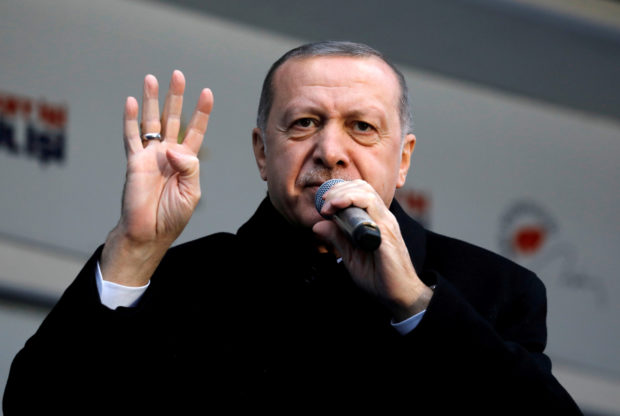 Turkish President Tayyip Erdogan addresses his supporters during a rally for the upcoming local elections in Istanbul, Turkey, February 16, 2019. REUTERS/Umit Bektas/File Photo