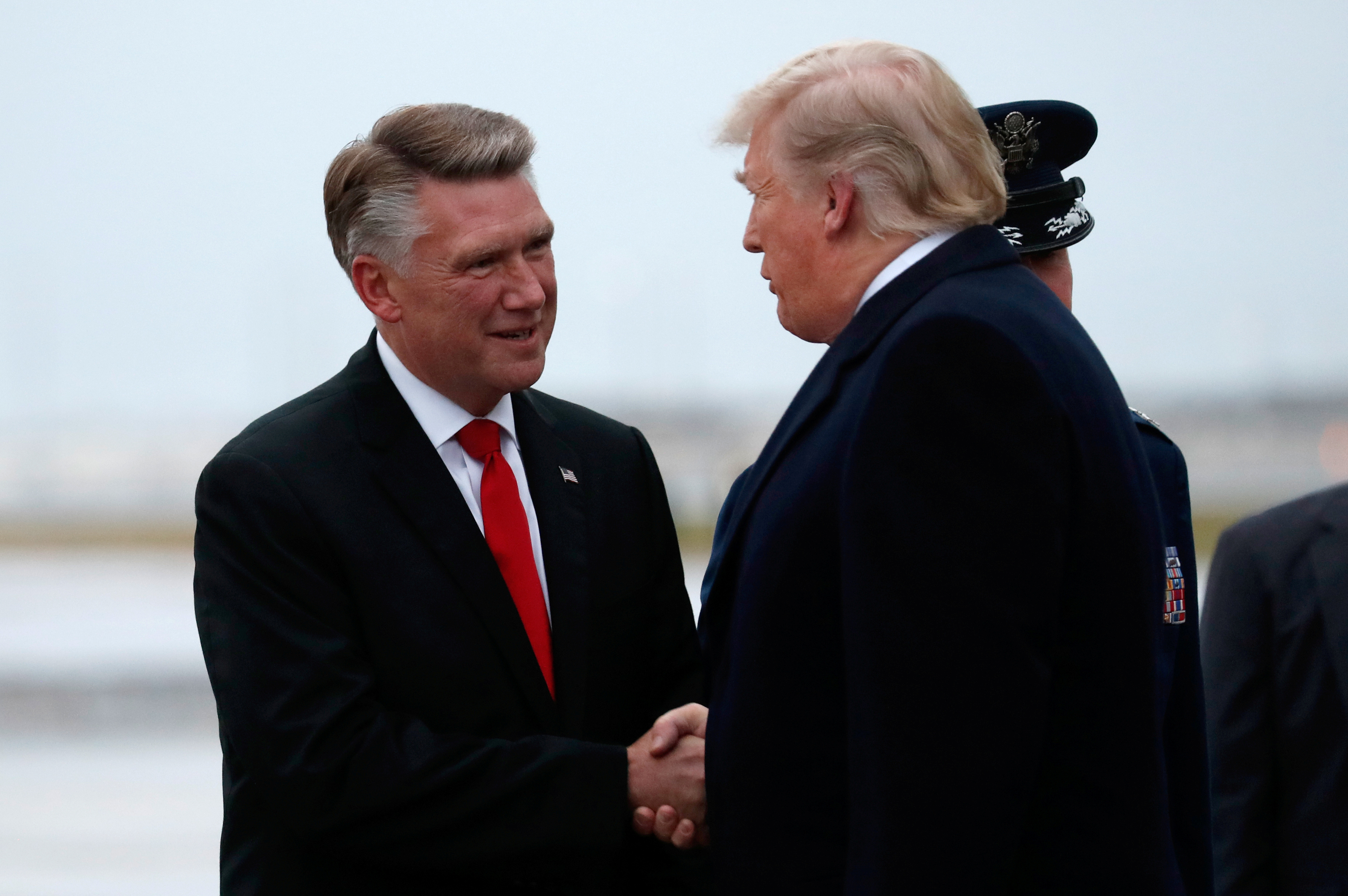 U.S. President Donald Trump greets Mark Harris, Republican candidate from North Carolina's 9th Congressional district, in Charlotte, North Carolina, U.S., October 26, 2018. REUTERS/Kevin Lamarque/File Photo