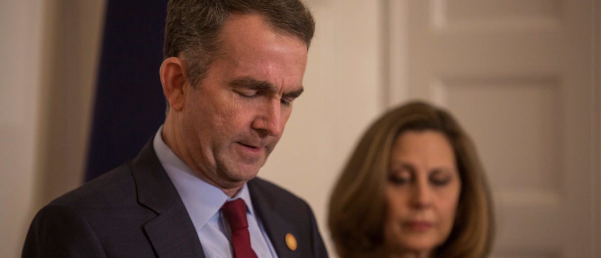 Virginia Governor Ralph Northam, accompanied by his wife Pamela Northam announces he will not resign during a news conference in Richmond, Virginia, U.S. February 2, 2019. Picture taken February 2, 2019. REUTERS/ Jay Paul