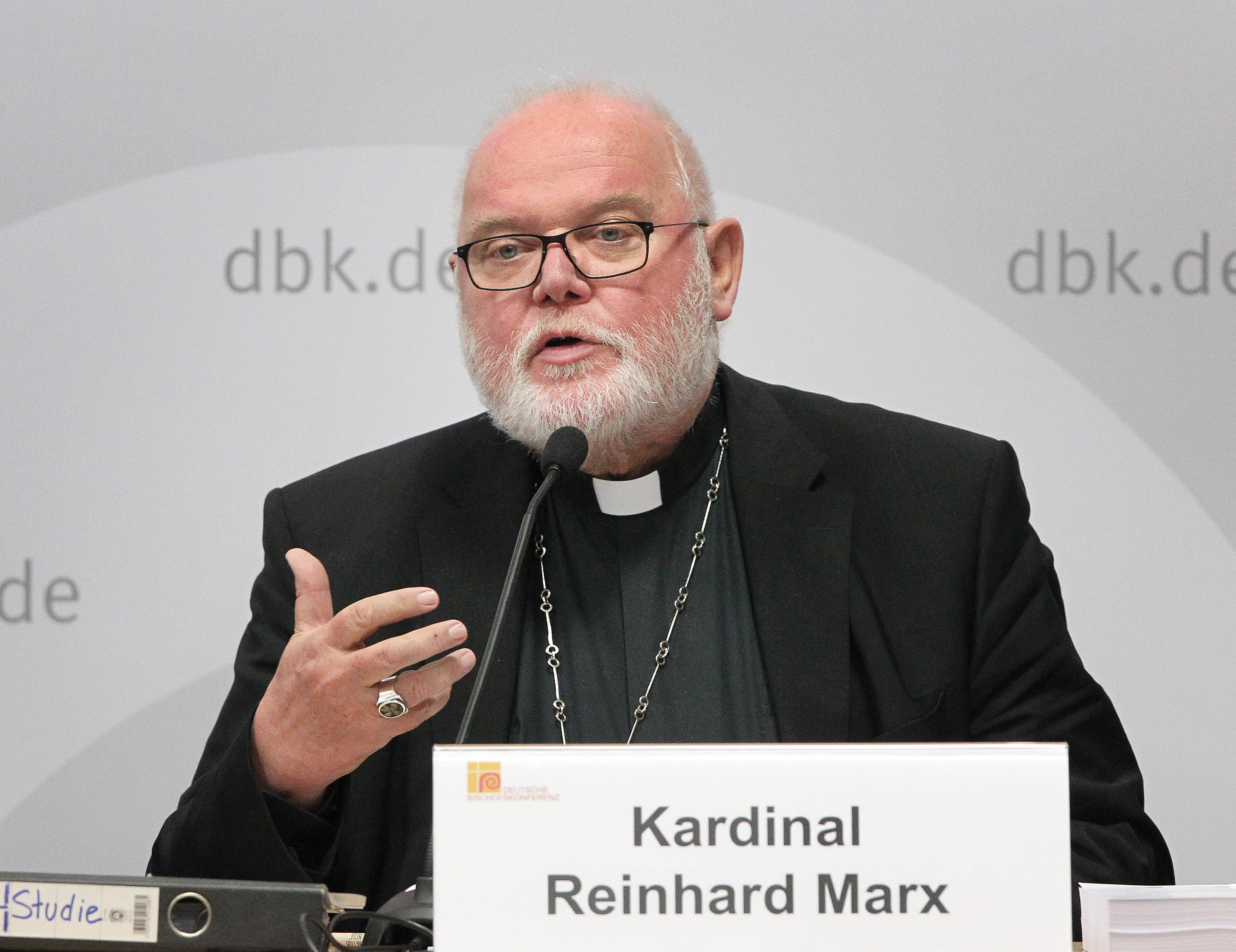 """Cardinal Reinhard Marx, Archbishop of Munich and Chairman of the German Bishops' Conference and Trier Bishop gives a press conference to present the results of the study on """"Sexual Abuse of Minors by Catholic Priests, Deacons and Male Religious"""" (MHG study) on September 25, 2018 in Fulda, western Germany. (DANIEL ROLAND/AFP/Getty Images)"""