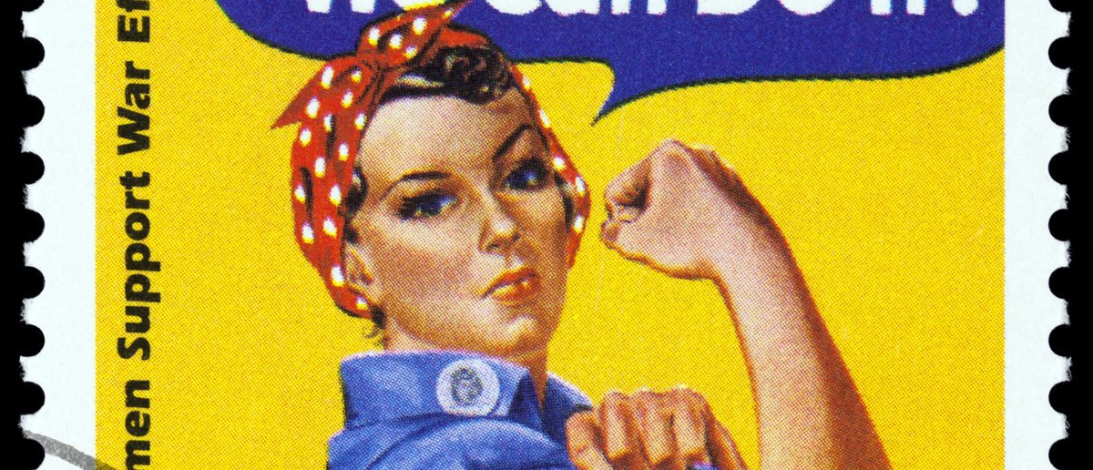 Canceled USA. postage stamp showing an image of Rosie The Riveter commemorating the American woman who worked in factories during the World War II, circa 1999. Shutterstock/TinaImages