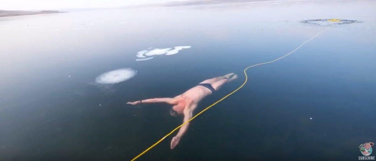 Freediving Under Clear Ice    ViralHog (Youtube screenshot: ViralHog)