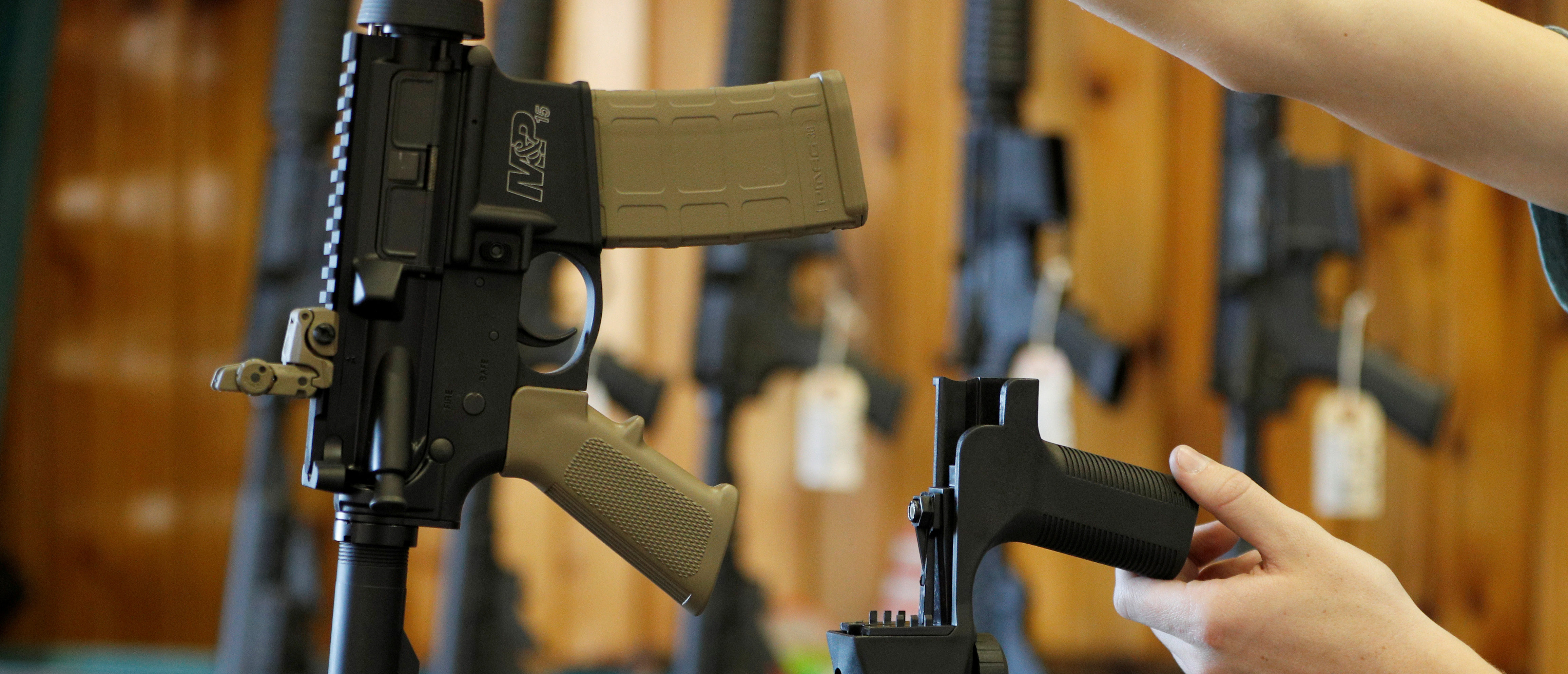 A bump fire stock, (R), that attaches to a semi-automatic rifle to increase the firing rate is seen at Good Guys Gun Shop in Orem, Utah, U.S., October 4, 2017. REUTERS/George Frey