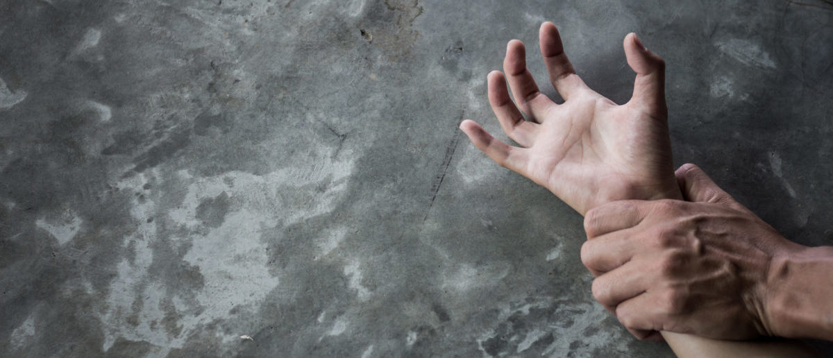 A migrant shelter worker was sentenced to 19 years in prison. SHUTTERSTOCK/ Tinnakorn jorruang