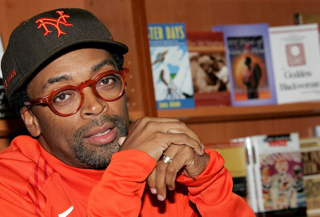 "Director Spike Lee answers questions during a book signing for ""That's My Story and I'm Sticking to It"" at Harlem's Hue-Man book store October 13, 2005 in New York City. (Photo by Paul Hawthorne/Getty Images)"