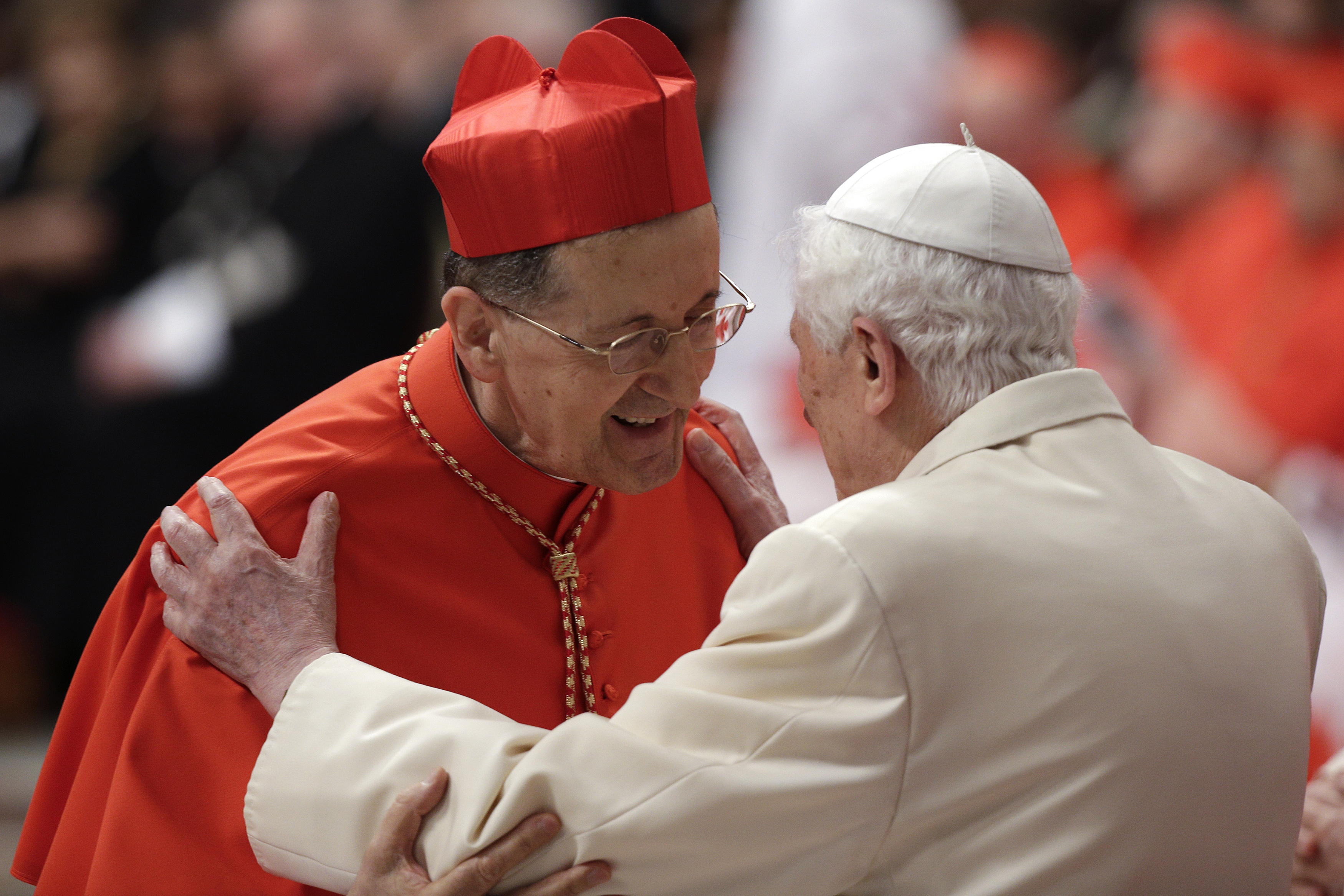 Former Pope Benedict XVI embraces newly elected cardinal Beniamino Stella of Italy during a consistory ceremony led by Pope Francis in Saint Peter's Basilica at the Vatican February 22, 2014. REUTERS/Max Rossi
