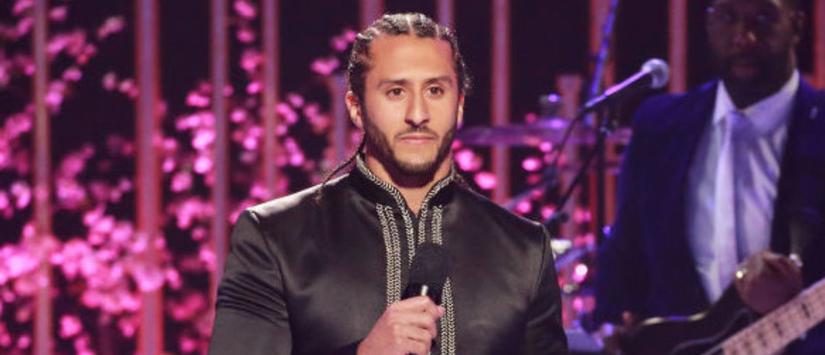 """LOS ANGELES, CA - MAY 03: NFL player Colin Kaepernick speaks onstage during VH1's 3rd Annual """"Dear Mama: A Love Letter To Moms"""" - Inside Show at The Theatre at Ace Hotel on May 3, 2018 in Los Angeles, California. (Photo by Leon Bennett/Getty Images)"""