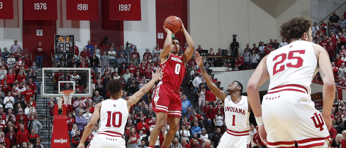 Feb 26, 2019; Bloomington, IN, USA; Wisconsin Badgers guard D'Mitrik Trice (0) makes a clutch three point shot against the Indiana Hoosiers to tie the game near the end of the first overtime at Assembly Hall. (Mandatory Credit: Brian Spurlock-USA TODAY Sports - via Reuters)