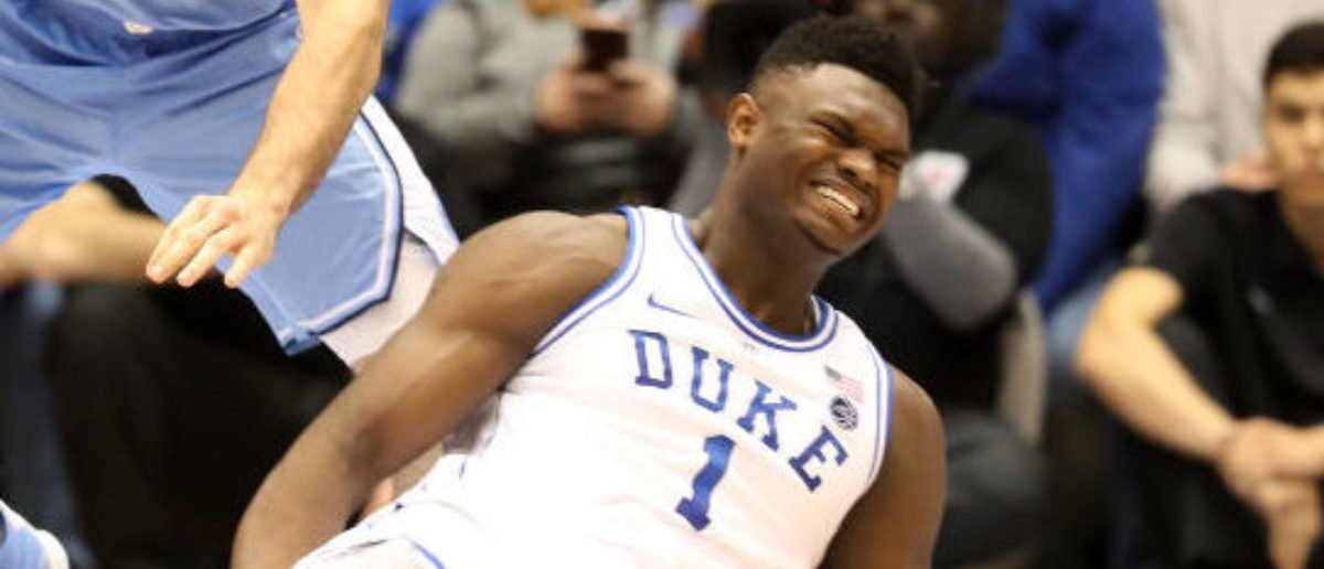 DURHAM, NORTH CAROLINA - FEBRUARY 20: Zion Williamson #1 of the Duke Blue Devils reacts after falling as his shoe breaks against Luke Maye #32 of the North Carolina Tar Heels during their game at Cameron Indoor Stadium on February 20, 2019 in Durham, North Carolina. (Photo by Streeter Lecka/Getty Images)