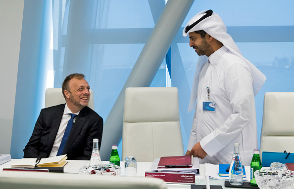 DOHA, QATAR - FEBRUARY 05: In this handout image released by FIFA World Cup Qatar 2022 LLC, Senior Qatar World Cup and FIFA officials announce a new joint venture to deliver 2022 FIFA World Cup. Qatar's Nasser Al Khater and FIFA's Colin Smith at the board in Doha, Qatar (Photo by FIFA World Cup Qatar 2022 LLC via Getty Images)