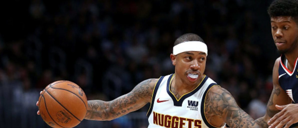DENVER, COLORADO - FEBRUARY 24: Isaiah Thomas #0 of the Denver Nuggets drives against Tyrone Wallace #9 of the Los Angeles Clippers in the fourth quarter at the Pepsi Center on February 24, 2019 in Denver, Colorado. (Photo by Matthew Stockman/Getty Images)