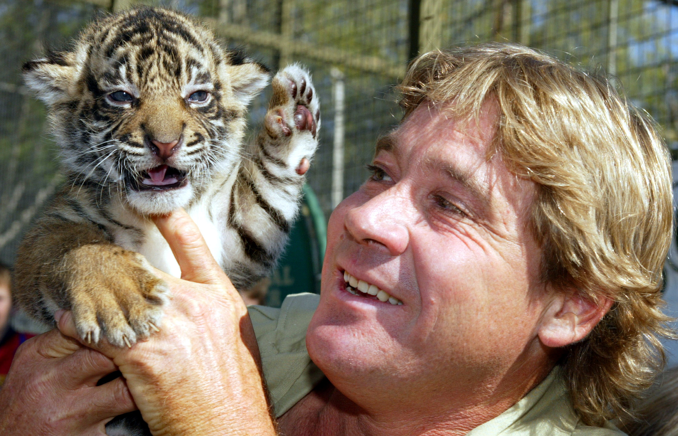 Australia's 'Crocodile Hunter' Steve Irwin holds a pure bred Sumatran tiger cub at Mogo Zoo south of Sydney April 27, 2004. Photo by Jim Ruymen/Reuters