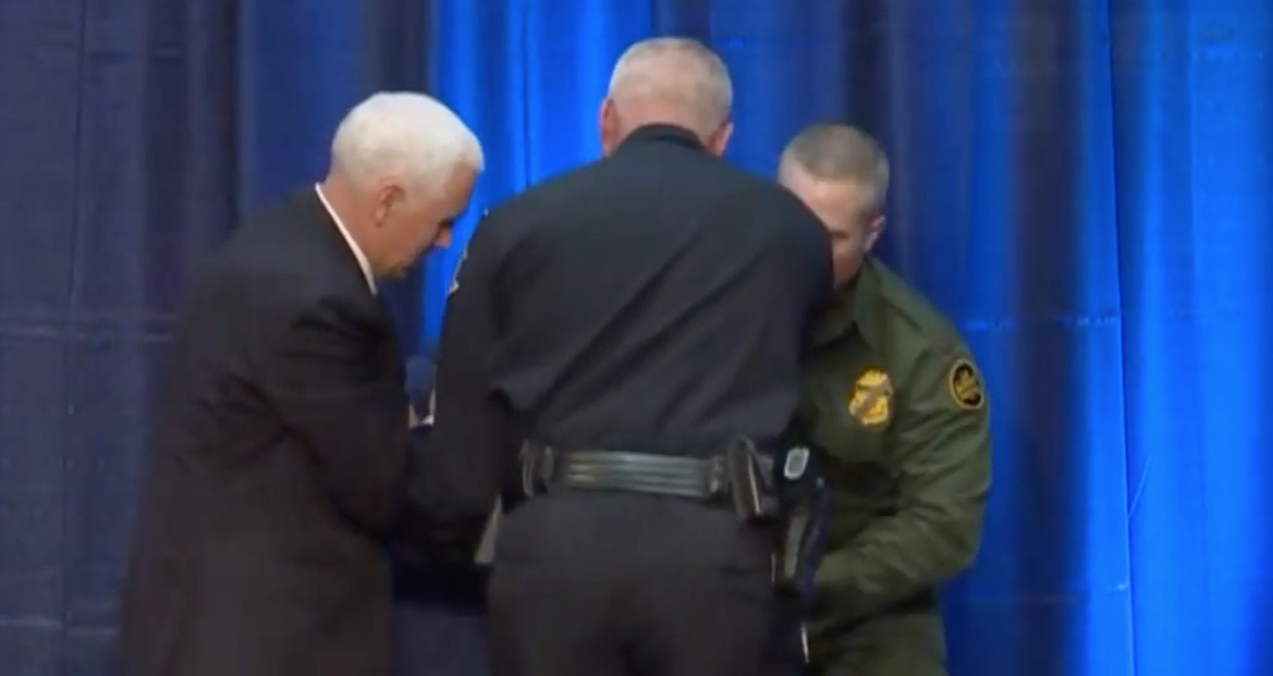Vice President Mike Pence assists a fainting member of the Coast Guard. Screen Shot/C-Span