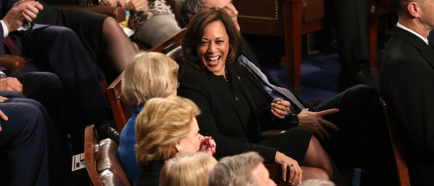 U.S. Senator Kamala Harris (D-CA) (R) talks with U.S. Senator Elizabeth Warren (D-MA) as U.S. President Donald Trump delivers his second State of the Union address to a joint session of Congress at the U.S. Capitol in Washington, U.S. February 5, 2019. REUTERS/Leah Millis
