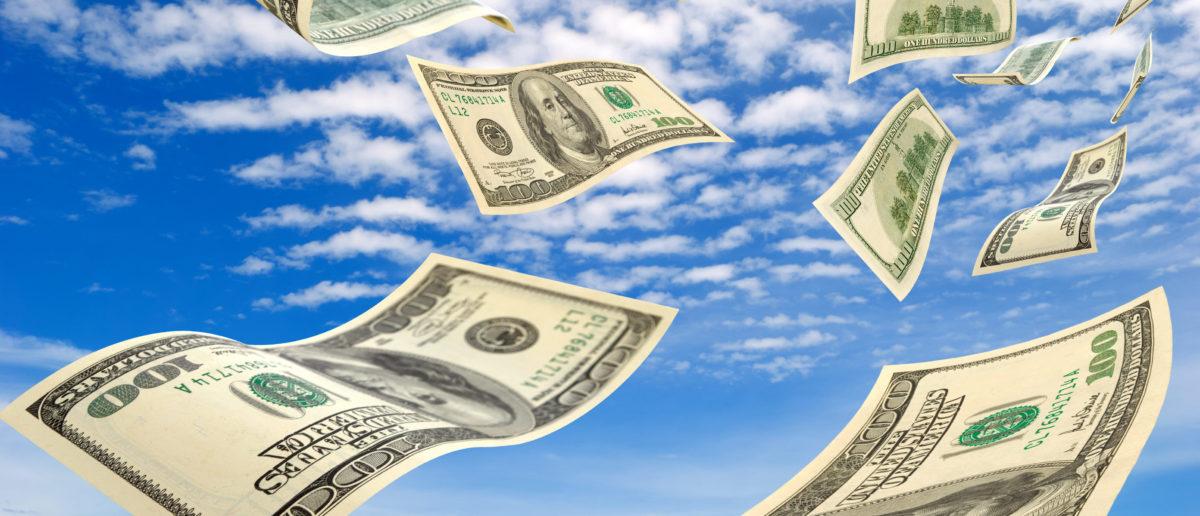Cash flies through the air. Shutterstock image via user Rrraum