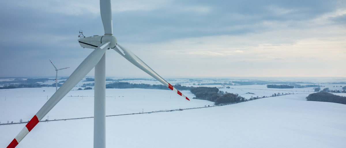 """As Congress debates the Green New Deal, which calls for a massive increase in renewable energy use, new reports show wind energy """"dropped off"""" as frigid Arctic air descended on the eastern U.S. earlier this year. Source: Stockr/Shutterstock"""