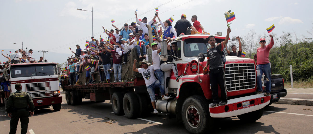 Venezuela's opposition supporters wave from a truck carrying humanitarian aid for Venezuela on the outskirts of Cucuta, near of the border line between Colombia and Venezuela, Colombia, February 23, 2019. REUTERS/Marco Bello