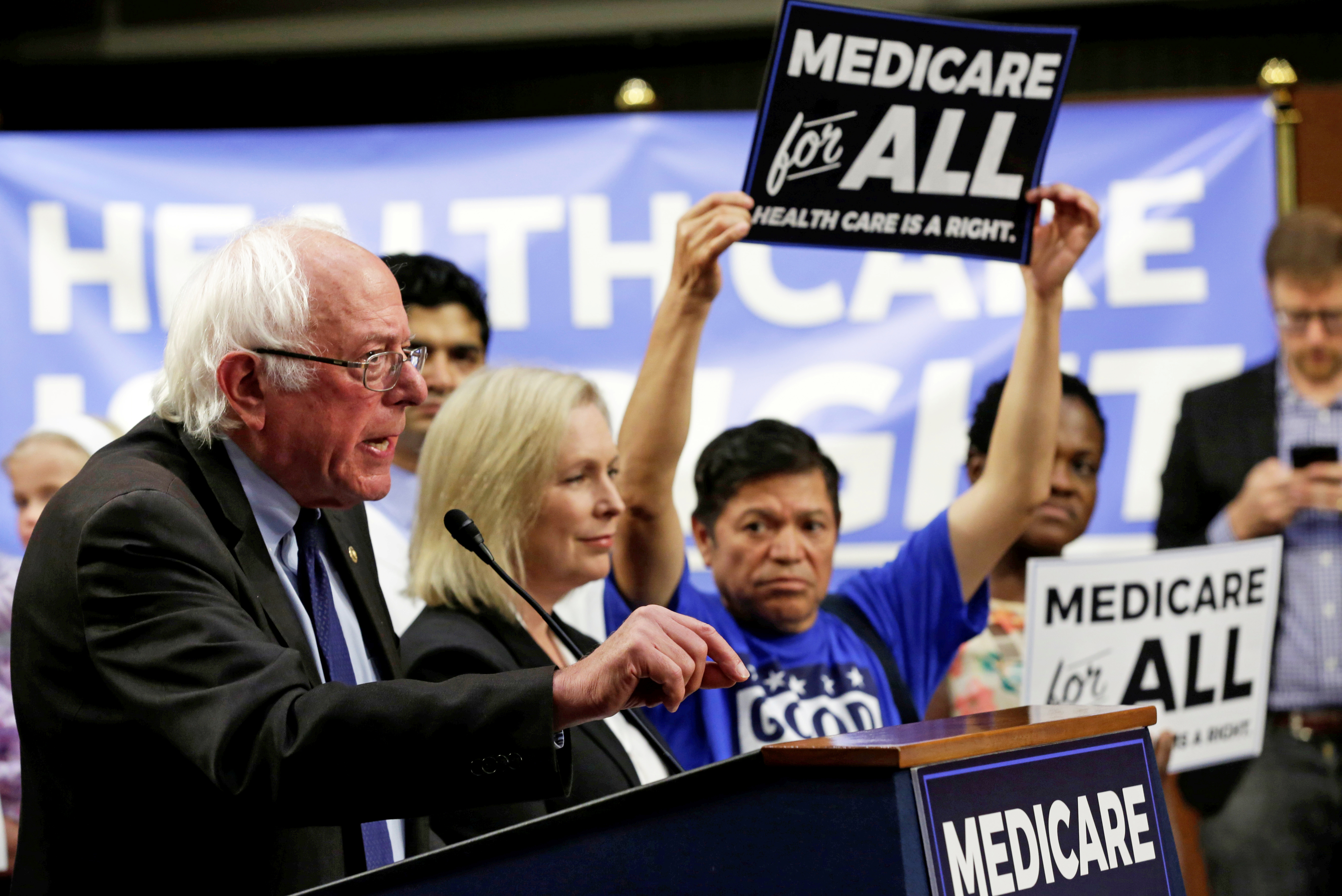 "FILE PHOTO: Senator Bernie Sanders (I-VT) speaks during an event to introduce the ""Medicare for All Act of 2017"" on Capitol Hill in Washington, U.S., September 13, 2017. REUTERS/Yuri Gripas/File Photo"