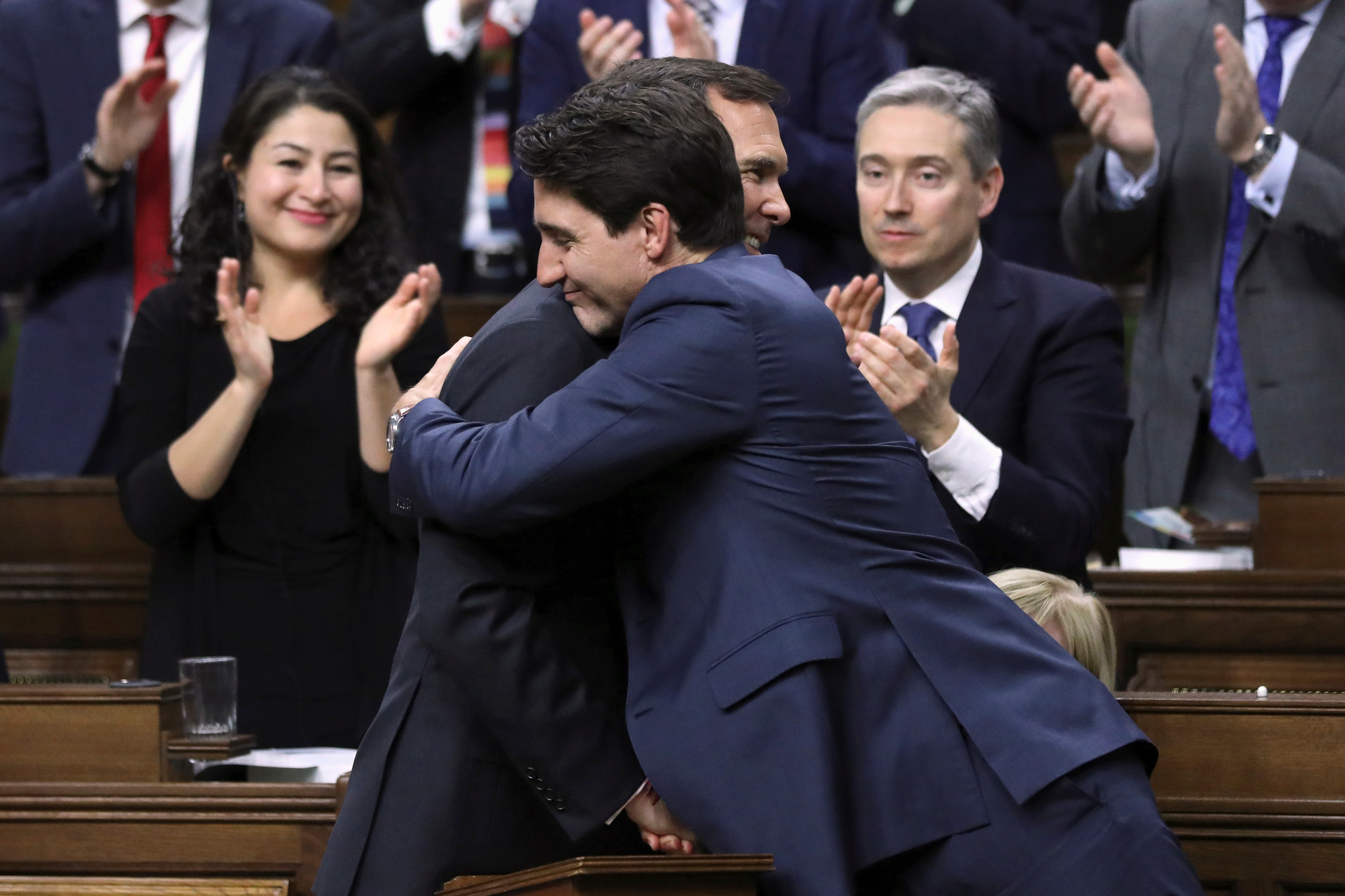 Canada's Prime Minister Justin Trudeau embraces Finance Minister Bill Morneau after Morneau delivered the budget in the House of Commons on Parliament Hill in Ottawa, Ontario, Canada, March 19, 2019. REUTERS/Chris Wattie