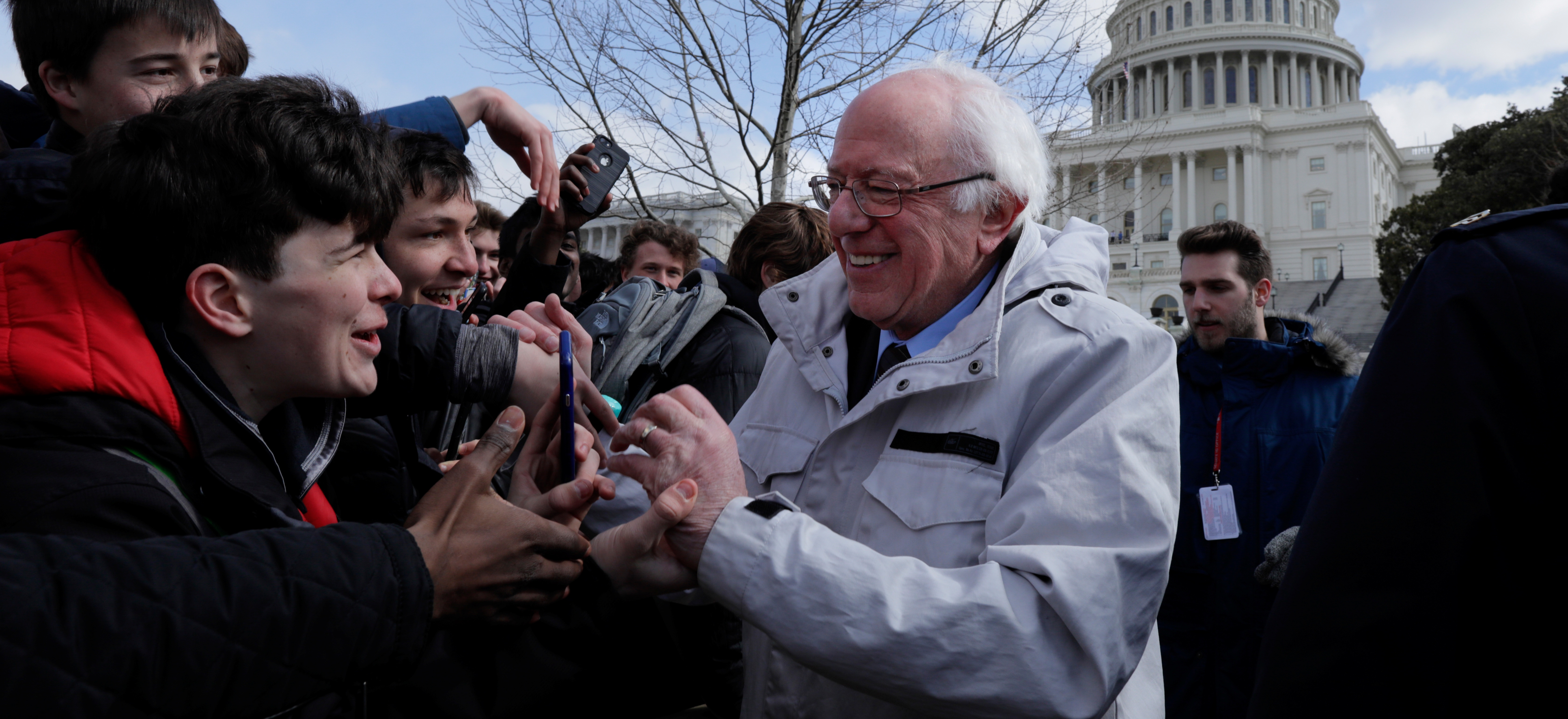 U.S. Senator Bernie Sanders (I-VT) greets students gathering outside the U.S. Capitol as part of a nationwide walk-out of classes to demand stricter gun laws in Washington, U.S., March 14, 2018. REUTERS/Jim Bourg