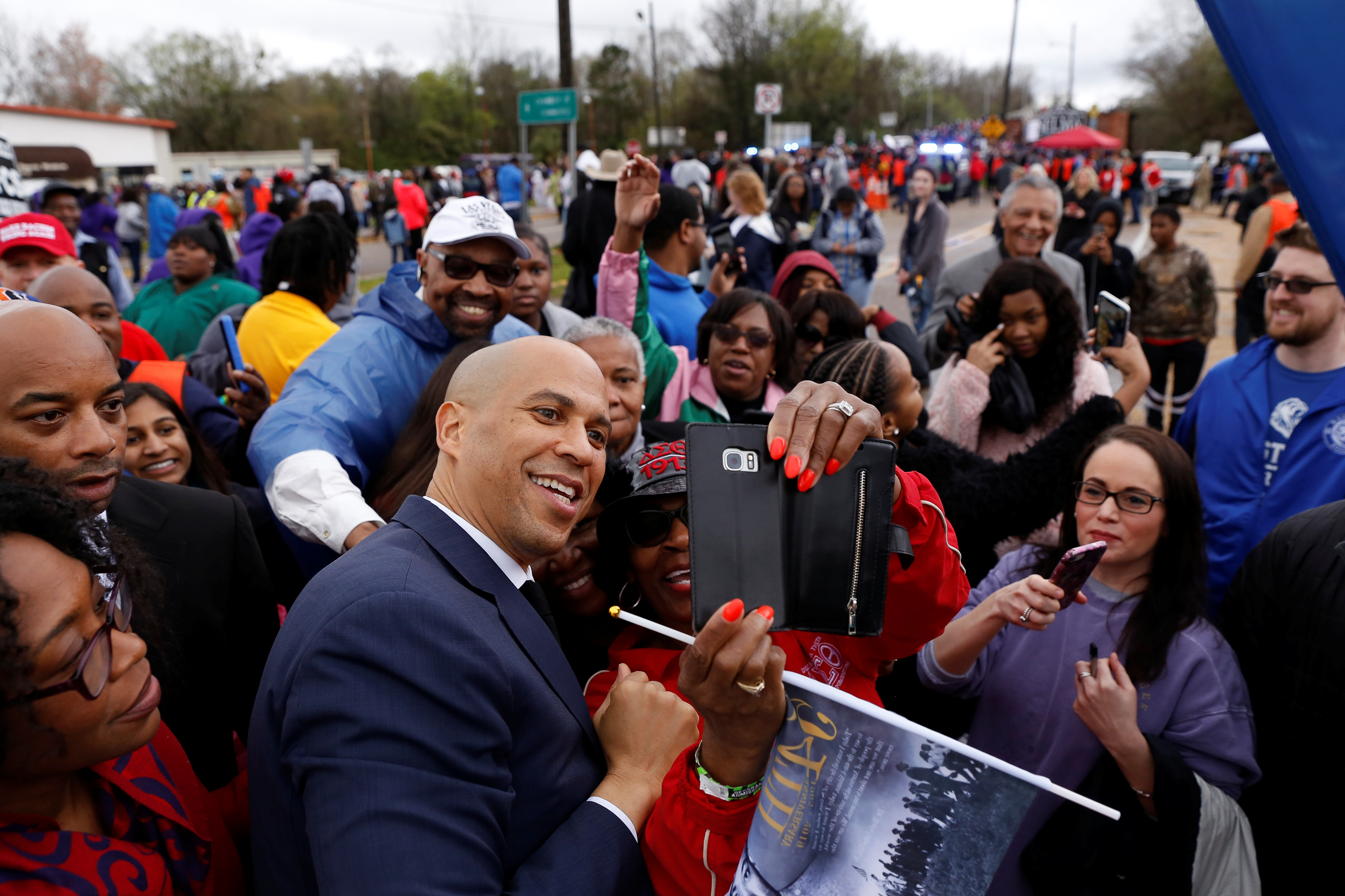 Democratic 2020 U.S. presidential candidate and U.S. Senator Cory Booker (D-NJ) takes a photo with supporters after marching across the Edmund Pettus Bridge during the Bloody Sunday commemorative march in Selma, Alabama, U.S. March 3, 2019. REUTERS/Chris Aluka Berry