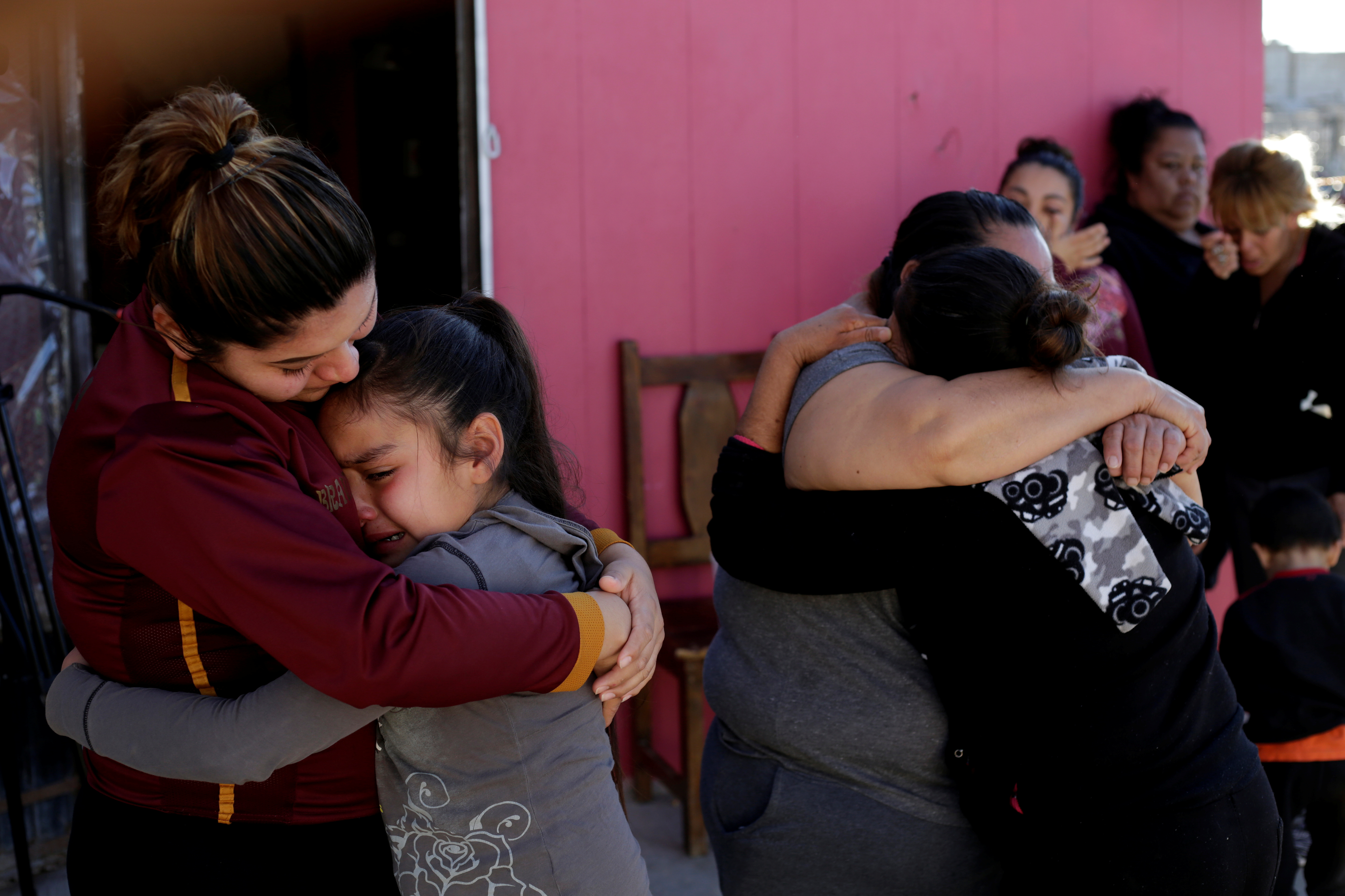 A woman embraces the daughter of Rene Pablo Perez, a Mexican migrant who died at a hospital in El Paso, Texas, after being held by U.S. Customs and Border Protection (CBP), outside her home in Ciudad Juarez, Mexico March 19, 2019. REUTERS/Jose Luis Gonzalez