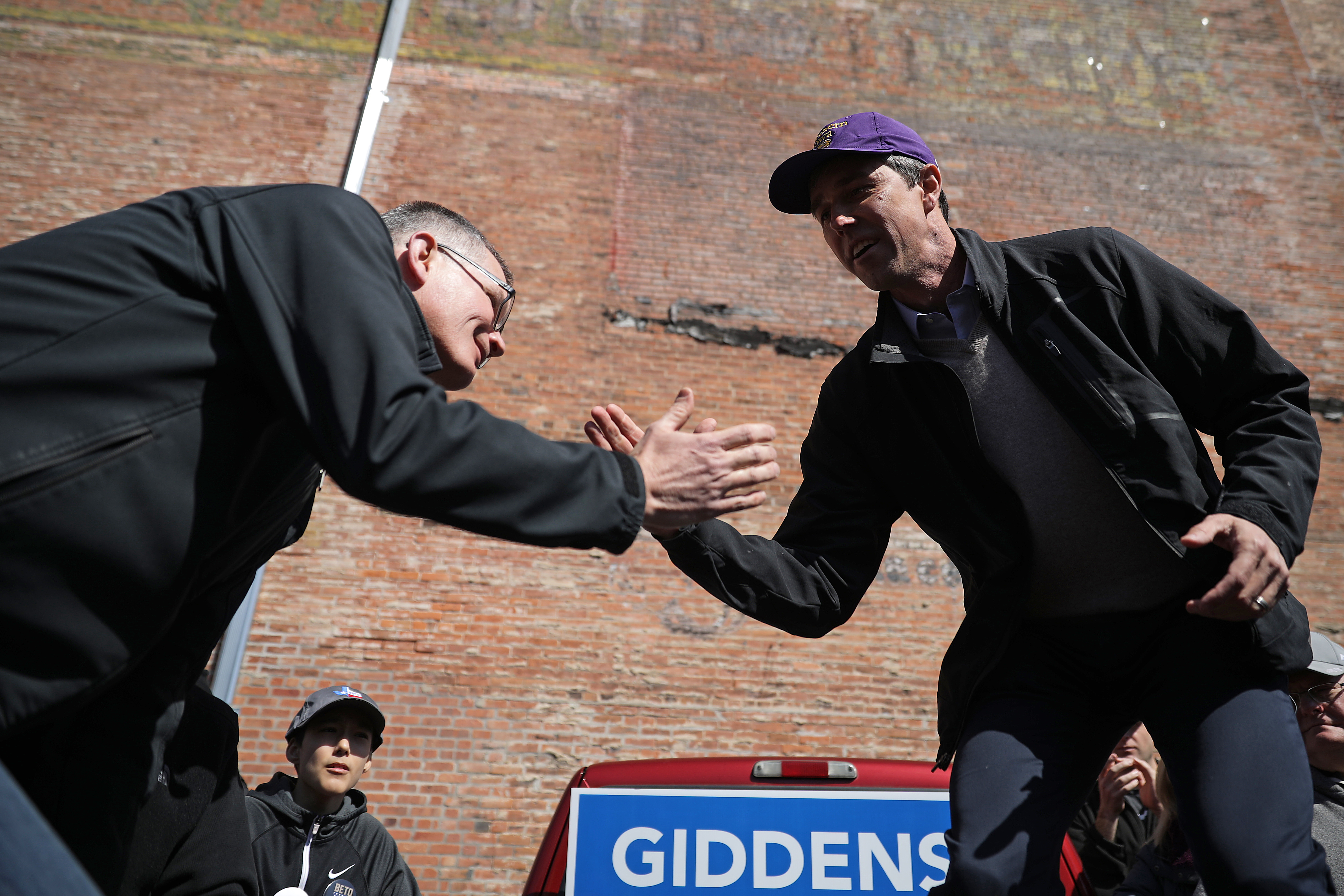 WATERLOO, IOWA - MARCH 16: Democratic presidential candidate Beto O'Rourke helps Iowa senate candidate Eric Giddens climb up into a pickup truck during a canvassing kickoff event March 16, 2019 in Waterloo, Iowa. After losing a long-shot race for U.S. Senate to Ted Cruz (R-TX), the 46-year-old O'Rourke is making his first campaign swing through Iowa after jumping into a crowded Democratic field this week. (Photo by Chip Somodevilla/Getty Images)
