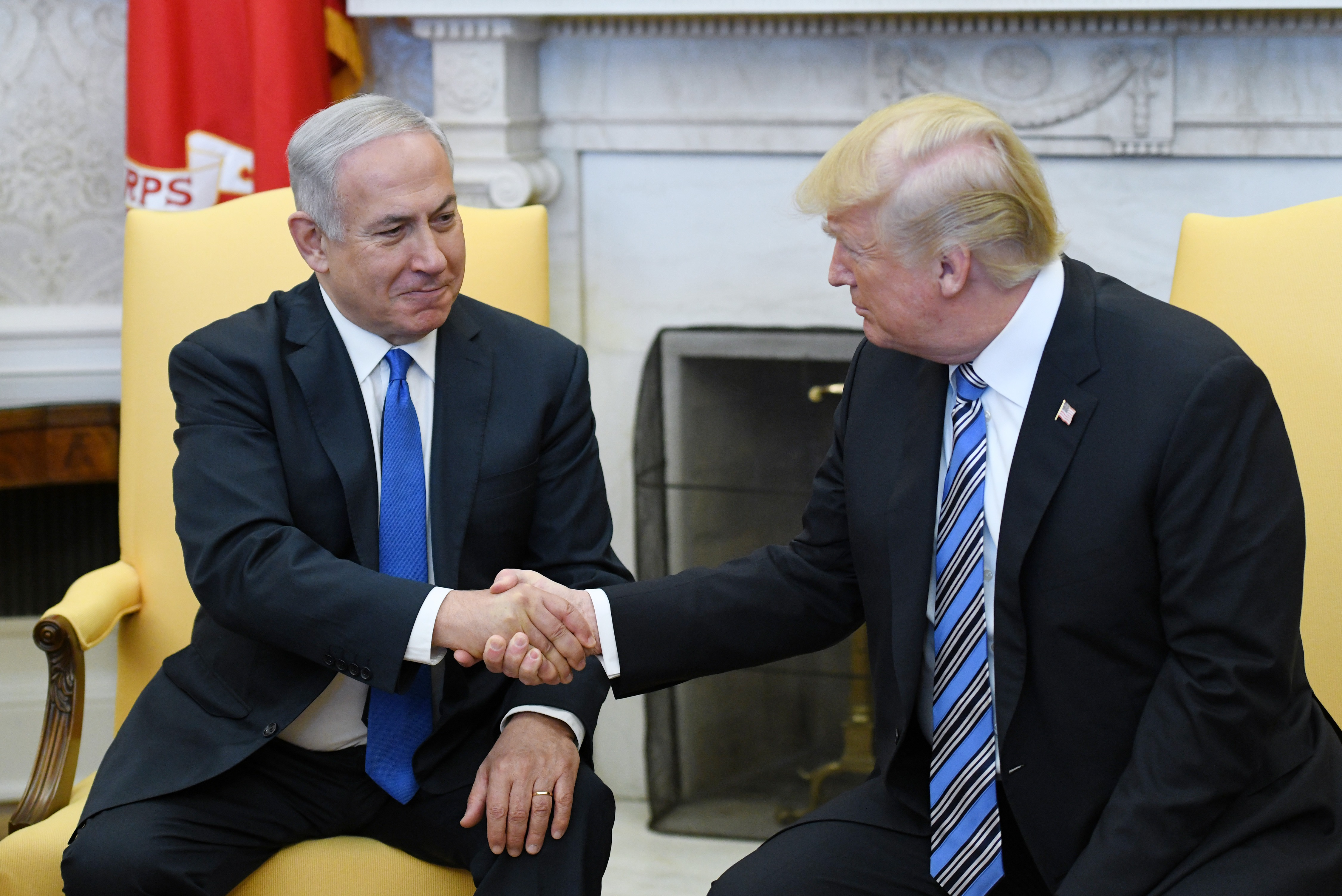 WASHINGTON, DC - MARCH 5: (AFP OUT) U.S. President Donald Trump (R) shakes hands withIsrael Prime Minister Benjamin Netanyahu as they meet in the Oval Office of the White House March 5, 2018 in Washington, DC. The prime minister is on an official visit to the US until the end of the week. (Photo by Olivier Douliery-Pool/Getty Images)