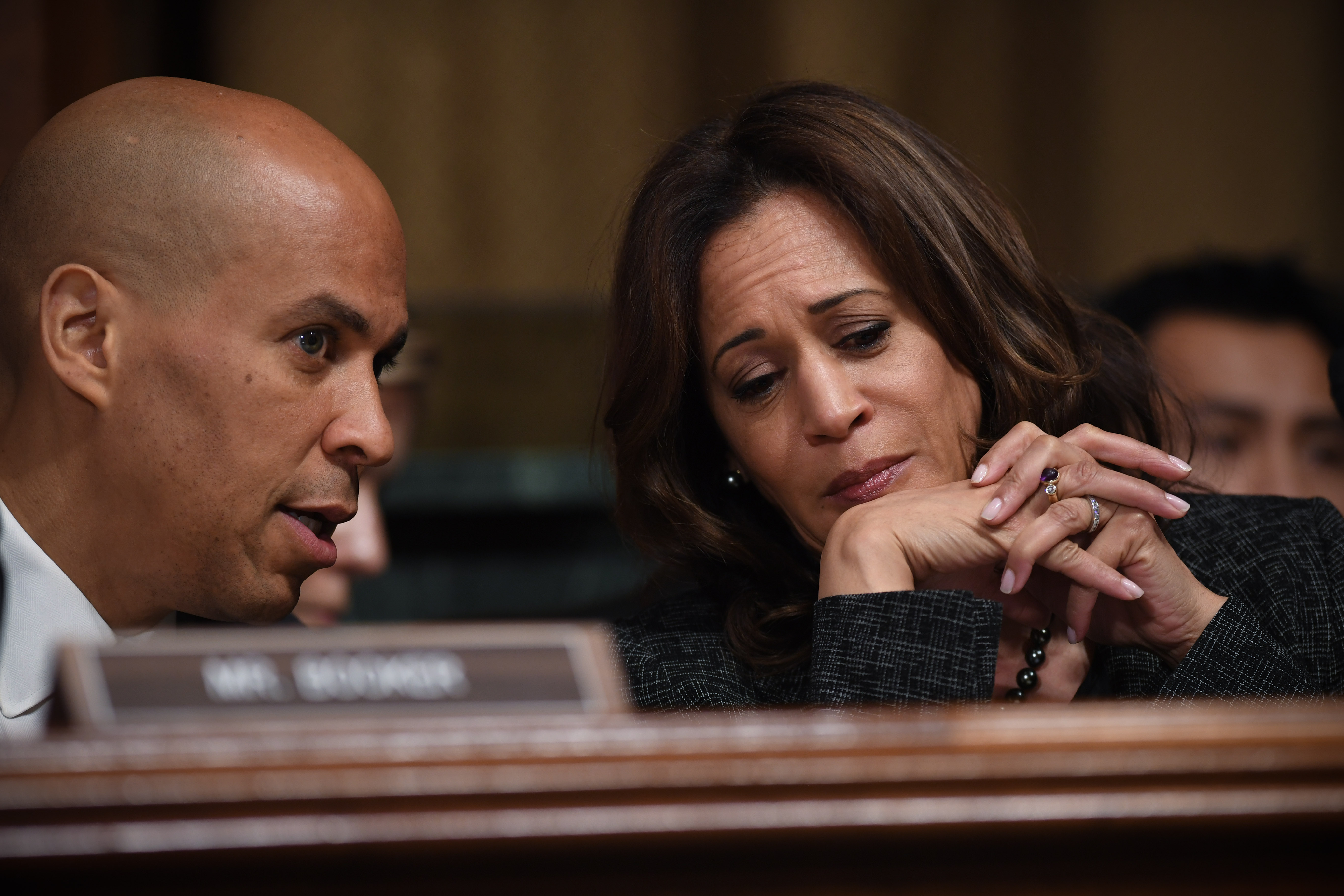 US Senators Cory Booker (L) and Kamala Harris (R) chat on Capitol Hill in Washington, DC, September 27, 2018. (Photo SAUL LOEB/AFP/Getty Images)