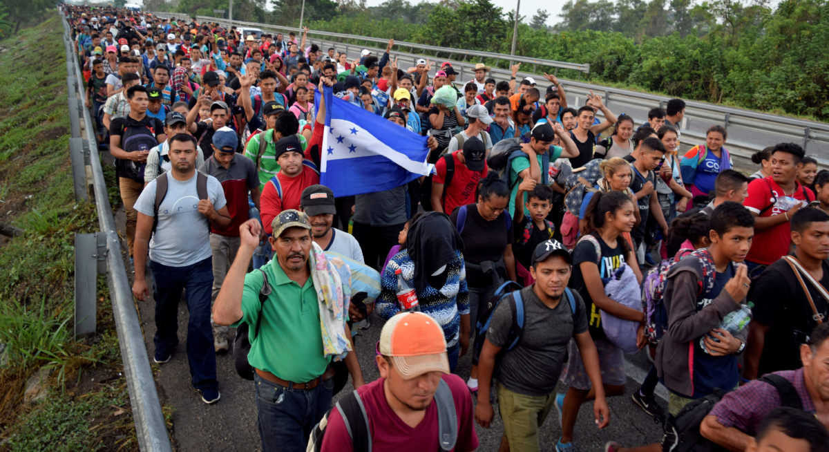 Migrants from Central America and Cuba walk on a highway during their journey towards the United States, in Tuzantan, in Chiapas state, Mexico March 25, 2019. REUTERS/Jose Torres