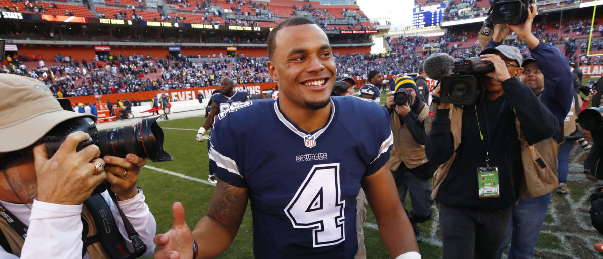Dak Prescott #4 of the Dallas Cowboys smiles after defeating the Cleveland Browns 35-10 at FirstEnergy Stadium on November 6, 2016 in Cleveland, Ohio. (Photo by Gregory Shamus/Getty Images)