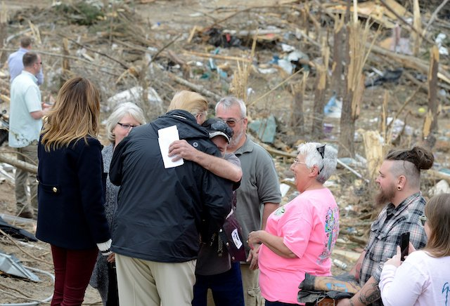 U.S. President Donald Trump is hugged by a resident who survived a tornado in Beauregard, Alabama, U.S., March 8, 2019. REUTERS/Mike Theiler