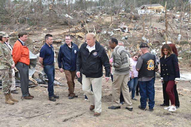 US President Donald Trump (C) tours a tornado-affected area with US first lady Melania Trump (R) and Ben Carson (center-right), US Secretary of Housing and Urban Development (HUD), on March 8, 2019 in Beauregard, Alabama. (Photo credit: NICHOLAS KAMM/AFP/Getty Images)