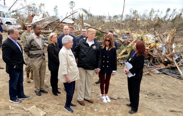 U.S. President Donald Trump and First Lady Melania Trump survey tornado damage with Alabama Gov. Kay Ivey and Lee Countyís Emergency Management Agency director Kathy Carson (R) at their sides as they tour the disaster area with U.S. Senator Doug Jones (D-AL), Secretary of Housing and Urban Development Ben Carson, Secretary of Homeland Security Kirstjen Nielsen and U.S. Senator Richard Shelby (R-AL) in Beauregard, Alabama, U.S., March 8, 2019. REUTERS/Mike Theiler