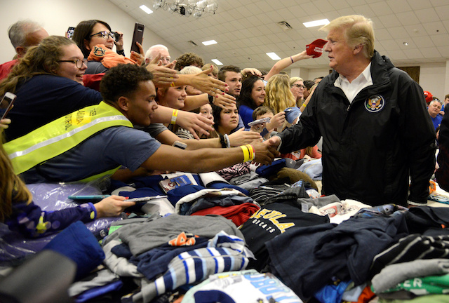 U.S. President Donald Trump greets volunteers who have sorted donated clothing at the Providence Baptist Church in Beauregard, Alabama, U.S., March 8, 2019. REUTERS/Mike Theiler