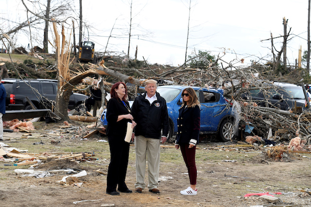 U.S. President Donald Trump and First Lady Melania Trump survey the damage and are briefed by Lee County Emergency Management Agency director Kathy Carson on the tornados that killed 23 people in the area earlier in the week in Beauregard, Alabama, U.S. March 8, 2019. REUTERS/Mike Theiler